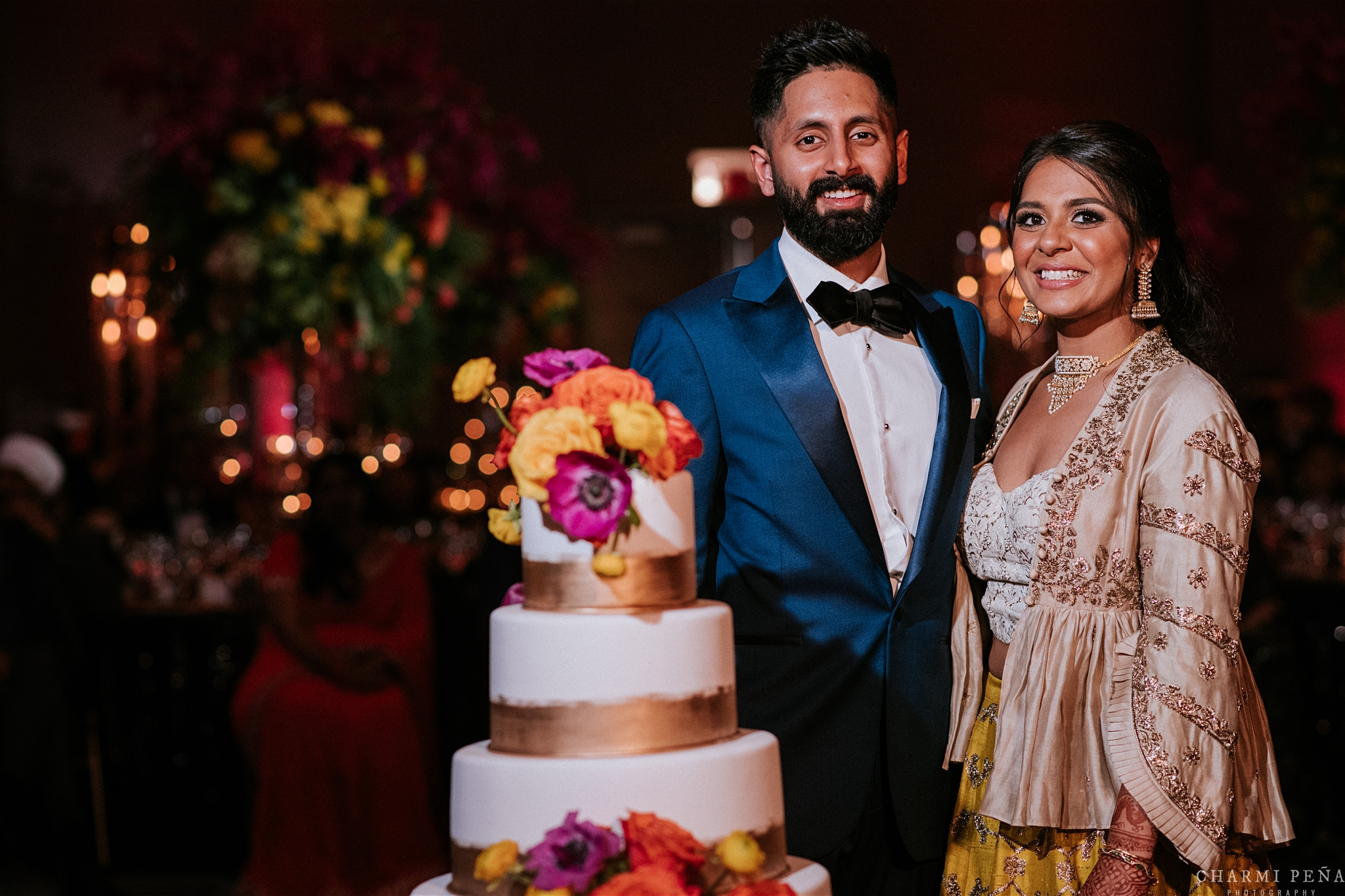 INDIAN WEDDING RECEPTION BRIDE AND GROOM CUTTING CAKE.jpg