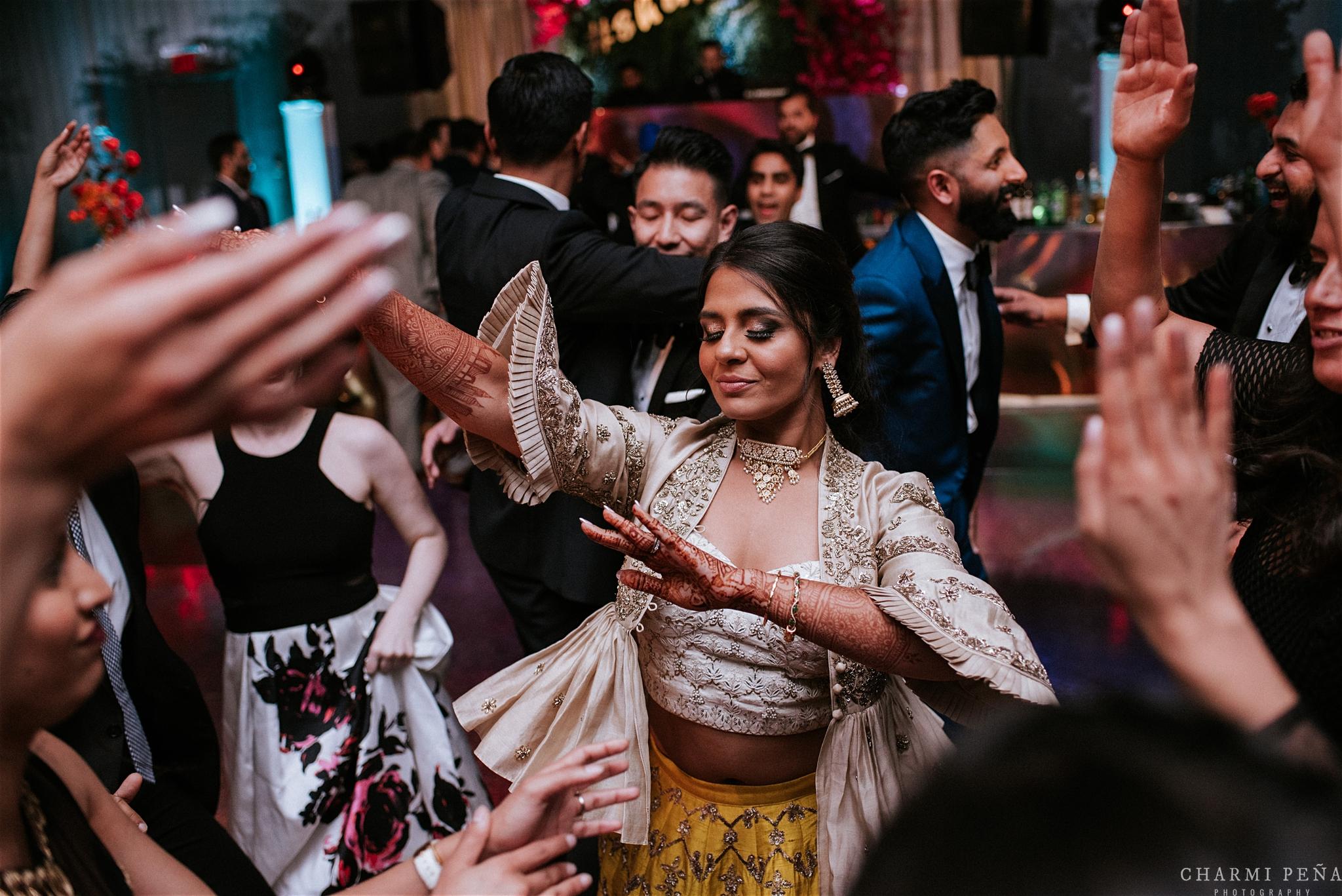 INDIAN WEDDING RECEPTION BRIDE DANCING2.jpg