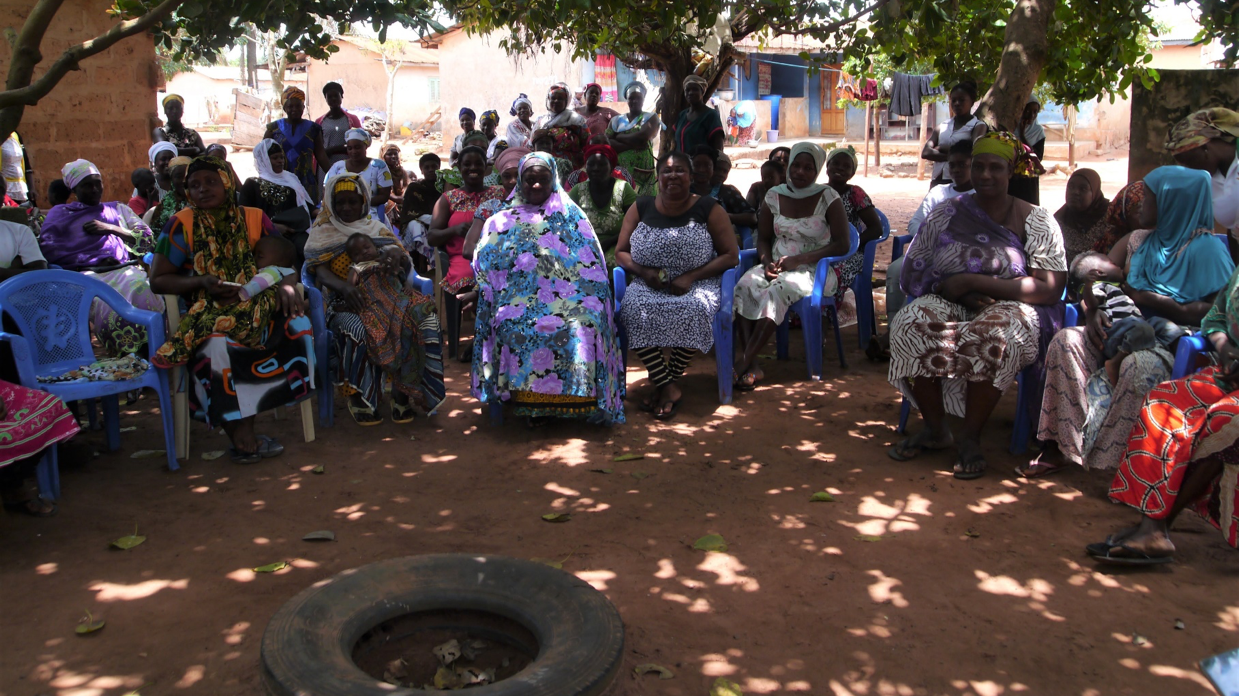 Four local Village Savings and Loans groups meet for their regular 'sharing out' session in Techiman North, Brong Ahafo.