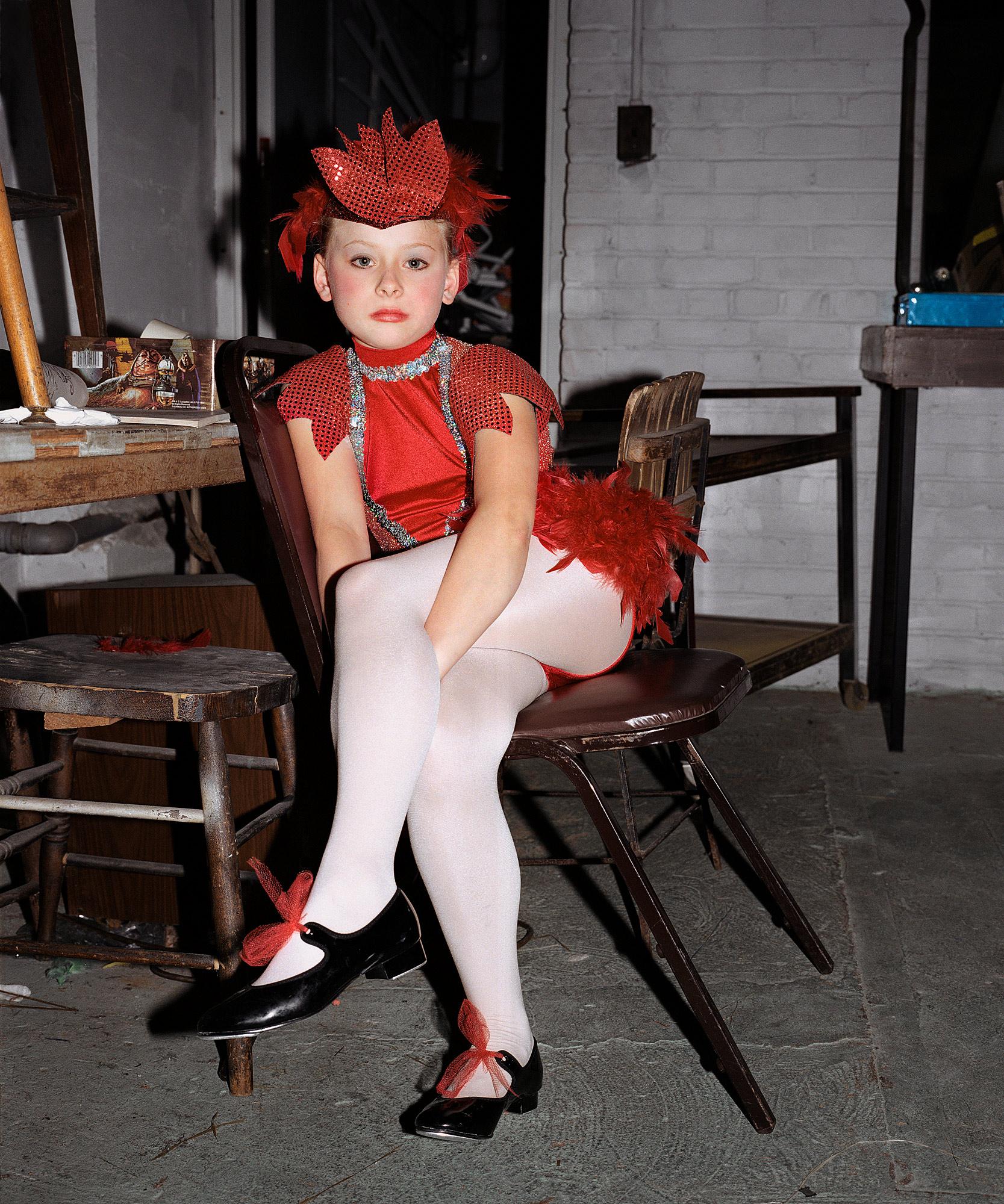 CareyKirkella_DanceRecital-redfeather.jpg