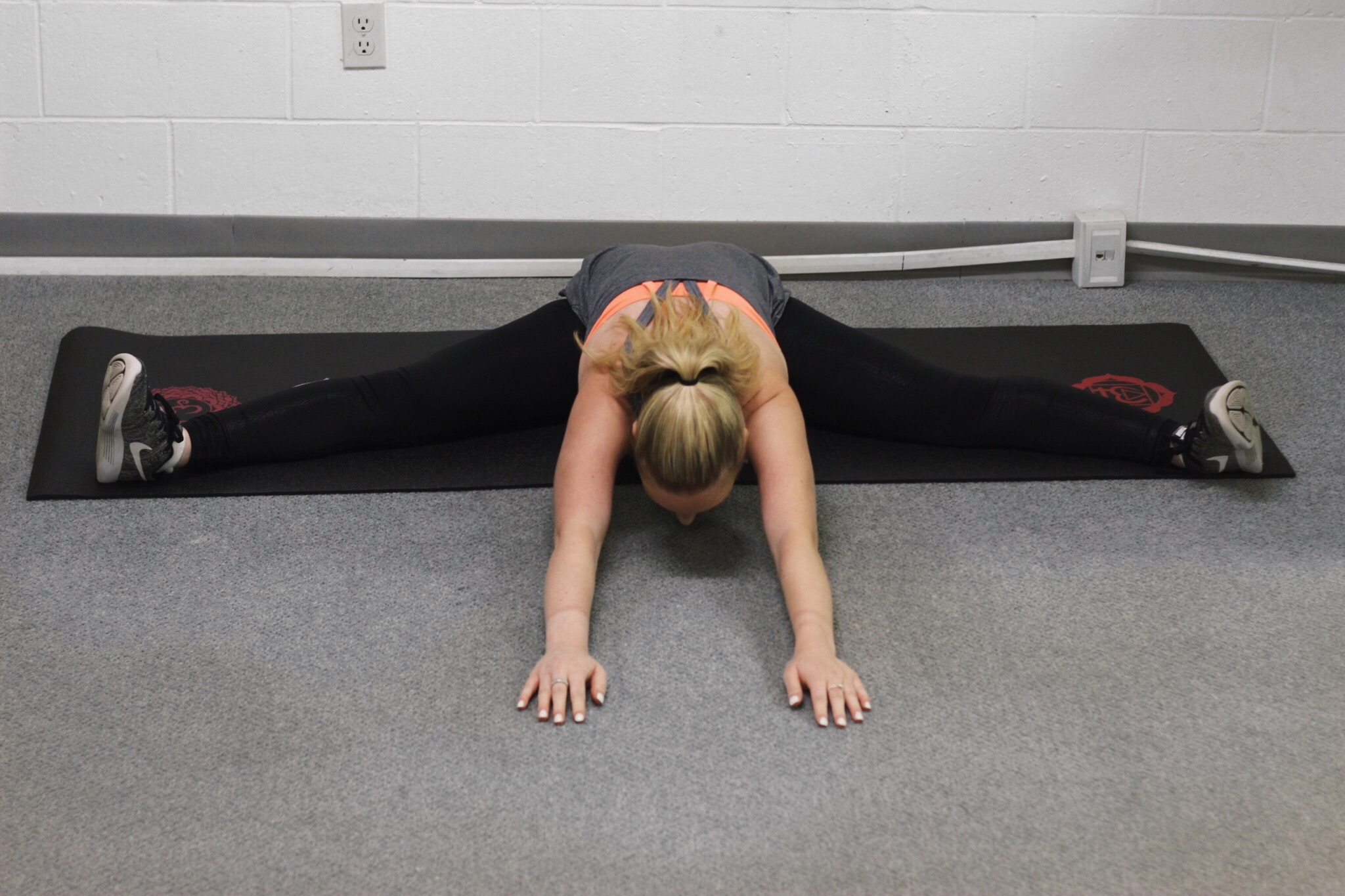 Straddle reaching into middle