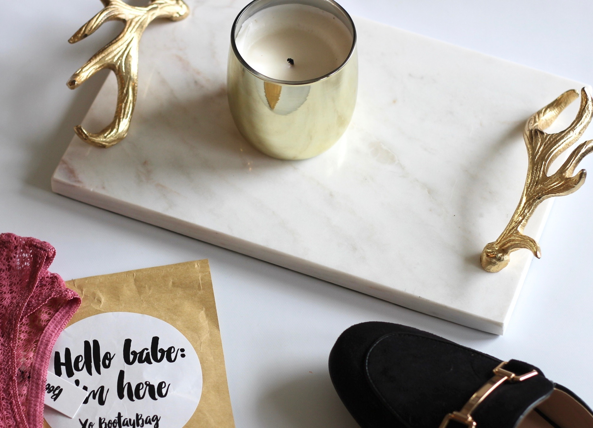 candle-marble-tray-gold-loafers.jpg