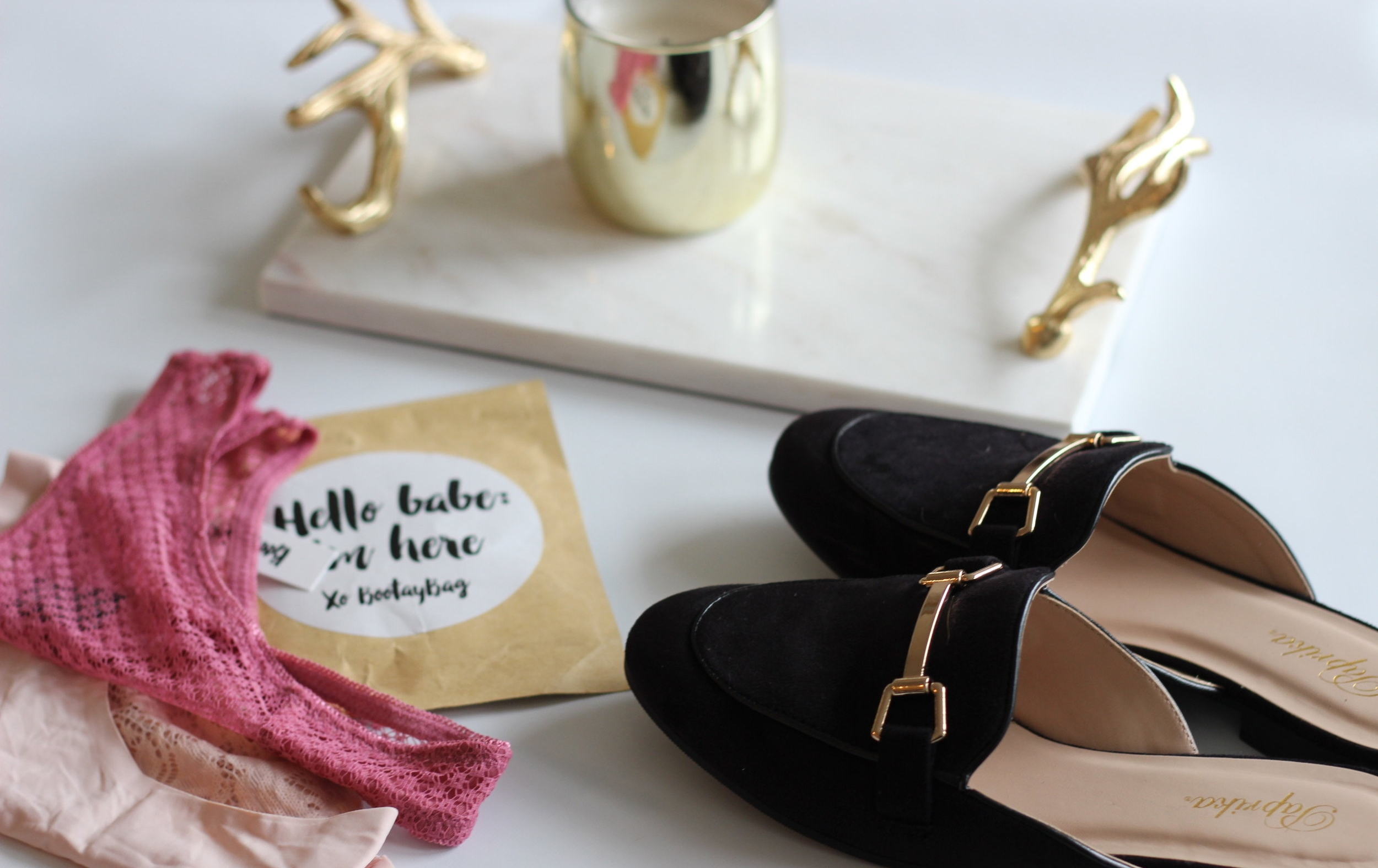 flatlay-loafers-slides-gold-accents-marble-tray-lace-underwear.jpg