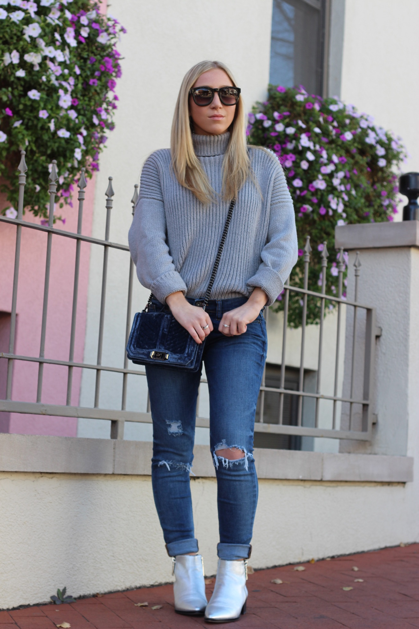 Winter style featuring metallic booties ripped jeans velvet cross body bag and grey turtleneck by Au Courant Life