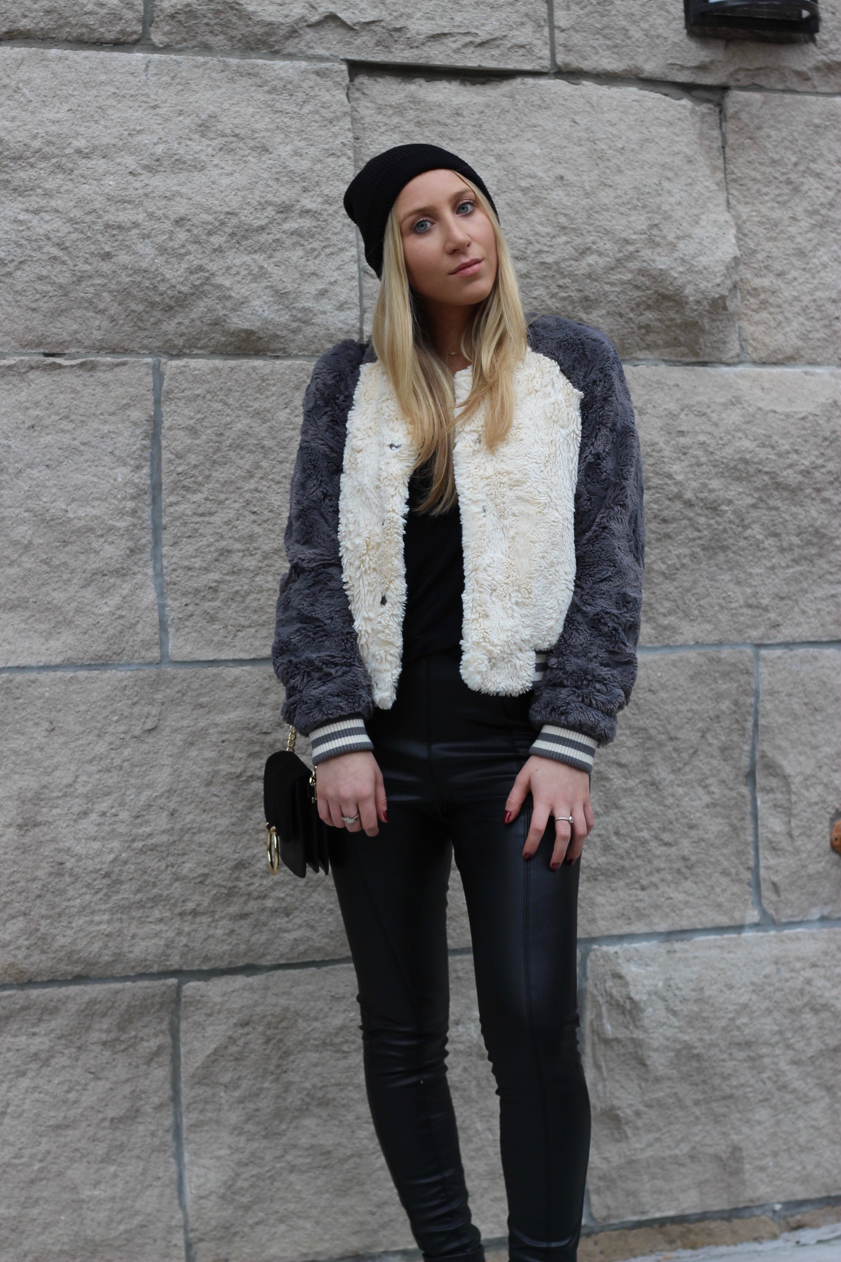 Fur bomber jacket and leather leggings by Au Courant Life