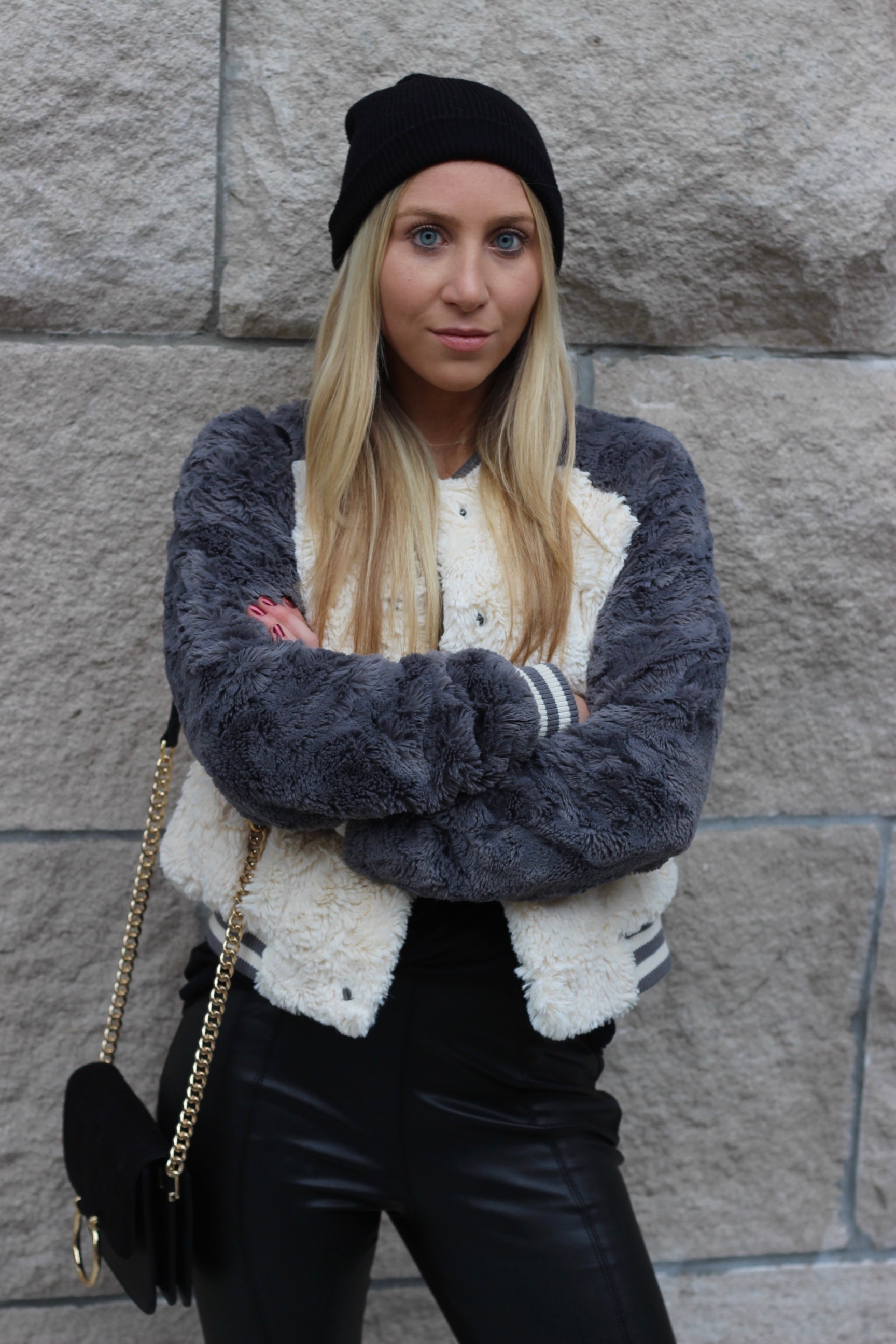 Carly of Au Courant Life wearing beanie and fur bomber