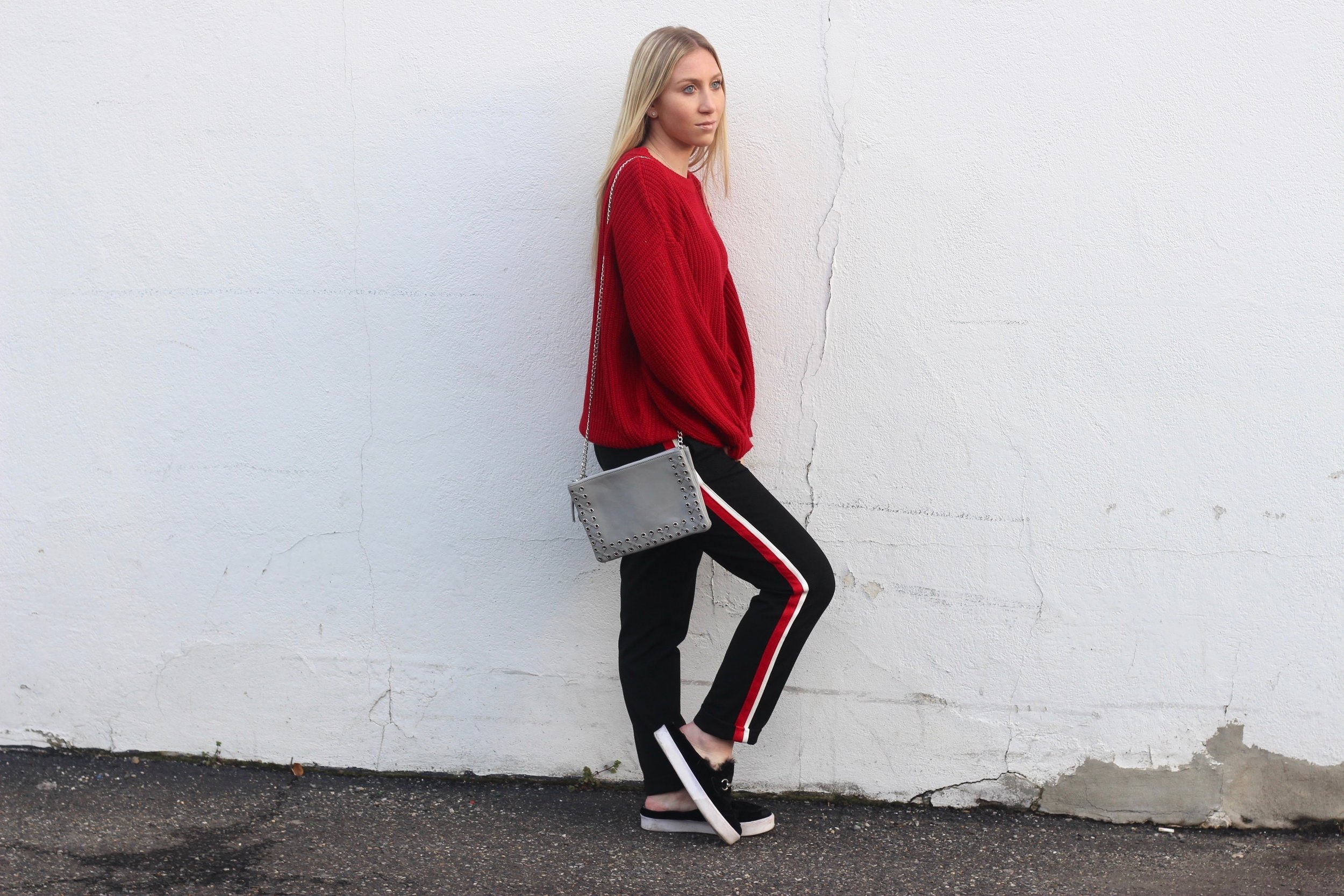 Carly of Au Courant Life wearing red and white striped trousers from Zara and red sweater