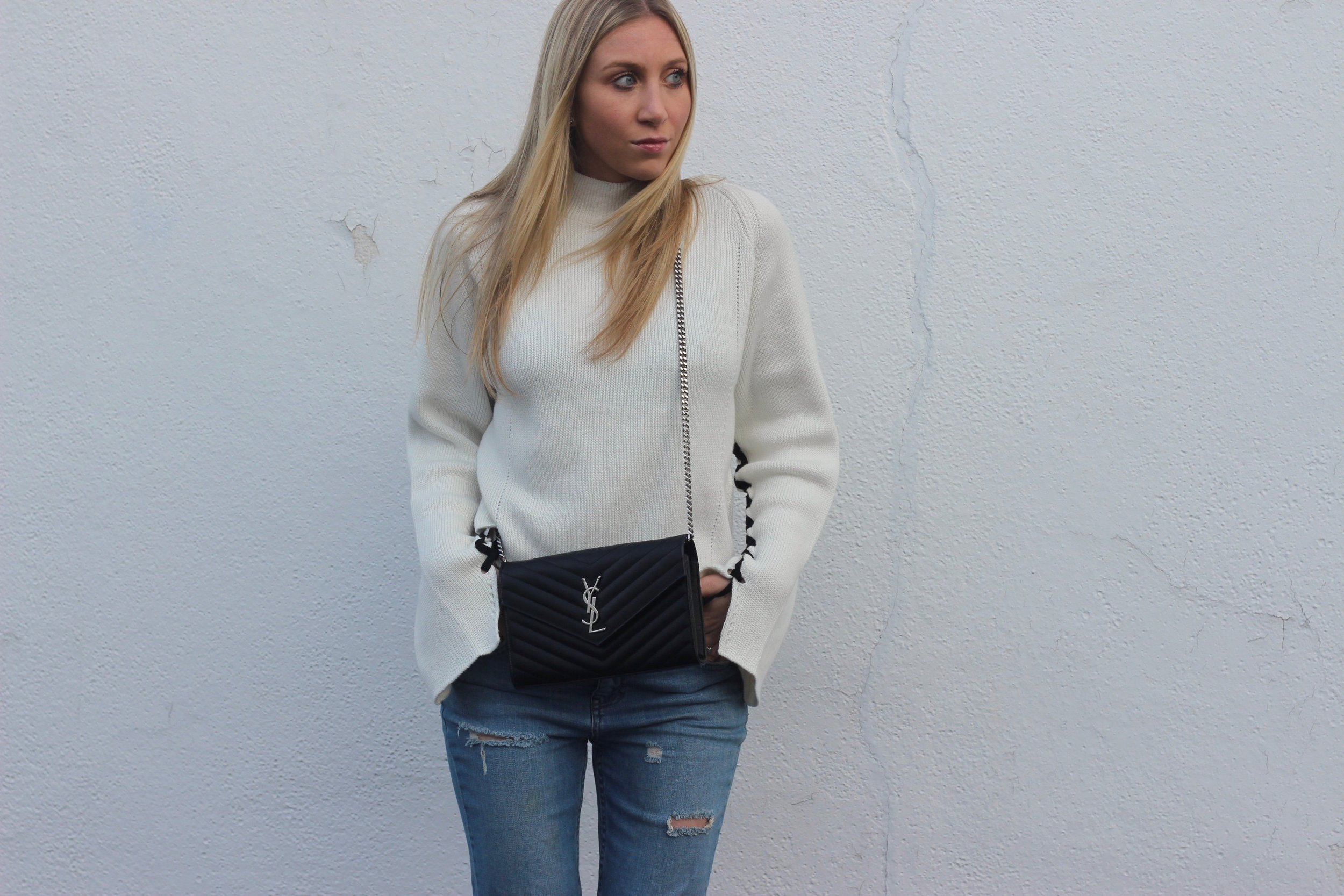 Boyfriend jeans, ysl bag, and statement sleeve sweater by Au Courant Life