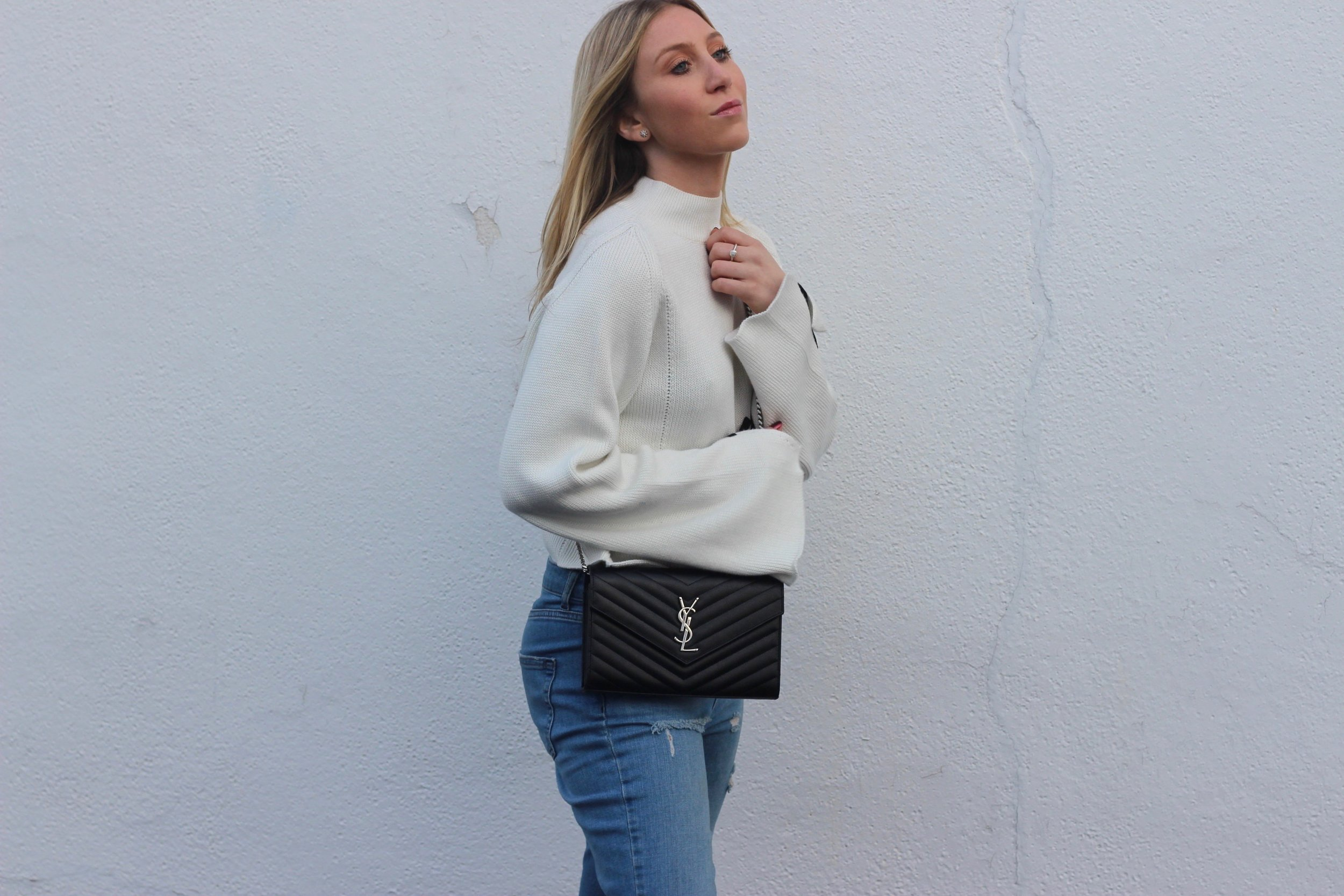 Ysl cross body bag and statement sweater by Au Courant Life