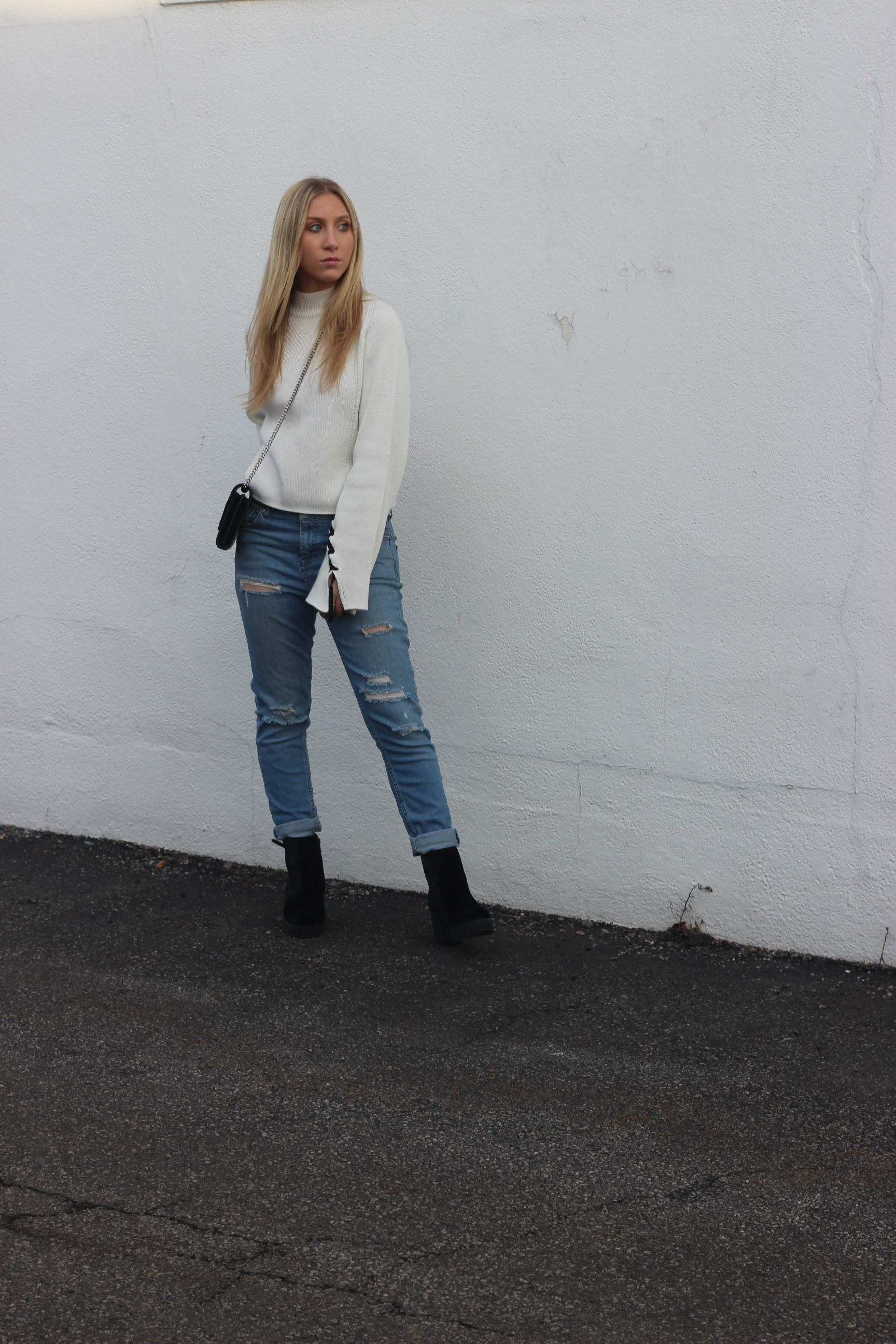 Aldo booties, statement sweater, boyfriend jeans, and saint laurent bag by Au Courant Life