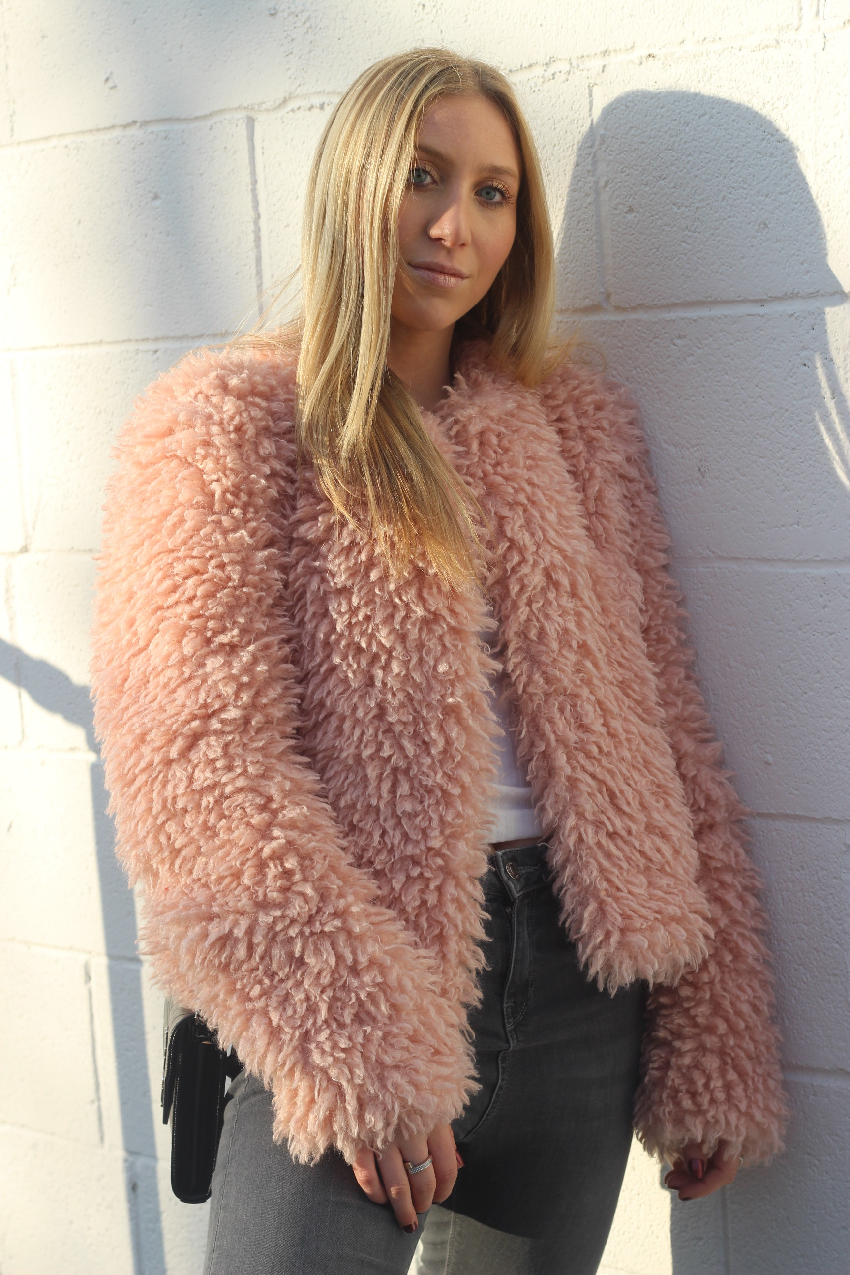 Carly of Au Courant Life in blush faux fur coat