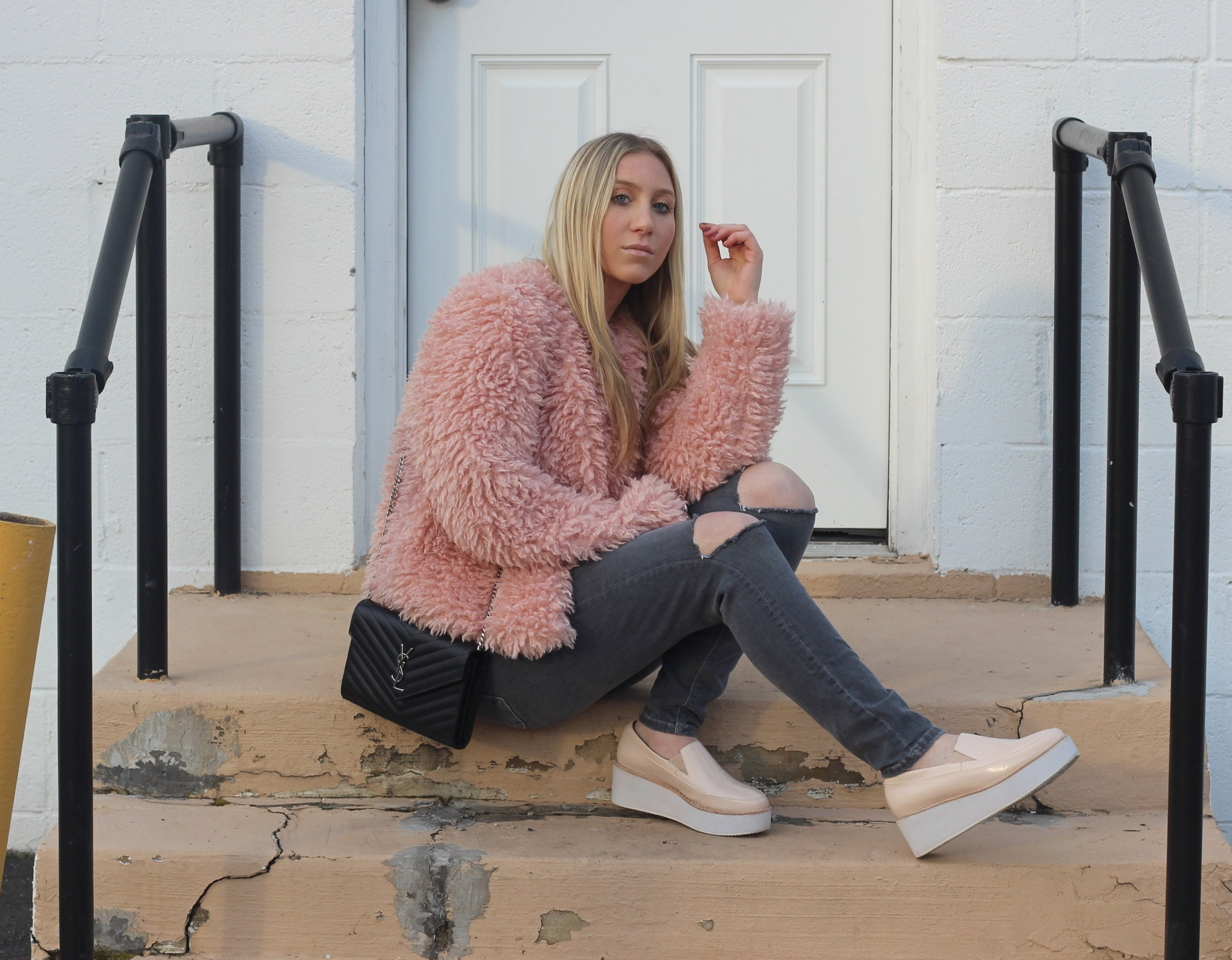 Carly of Au Courant Life in Forever 21 faux fur coat, Saint Laurent bag, Sol Sana shoes, and Topshop jeans