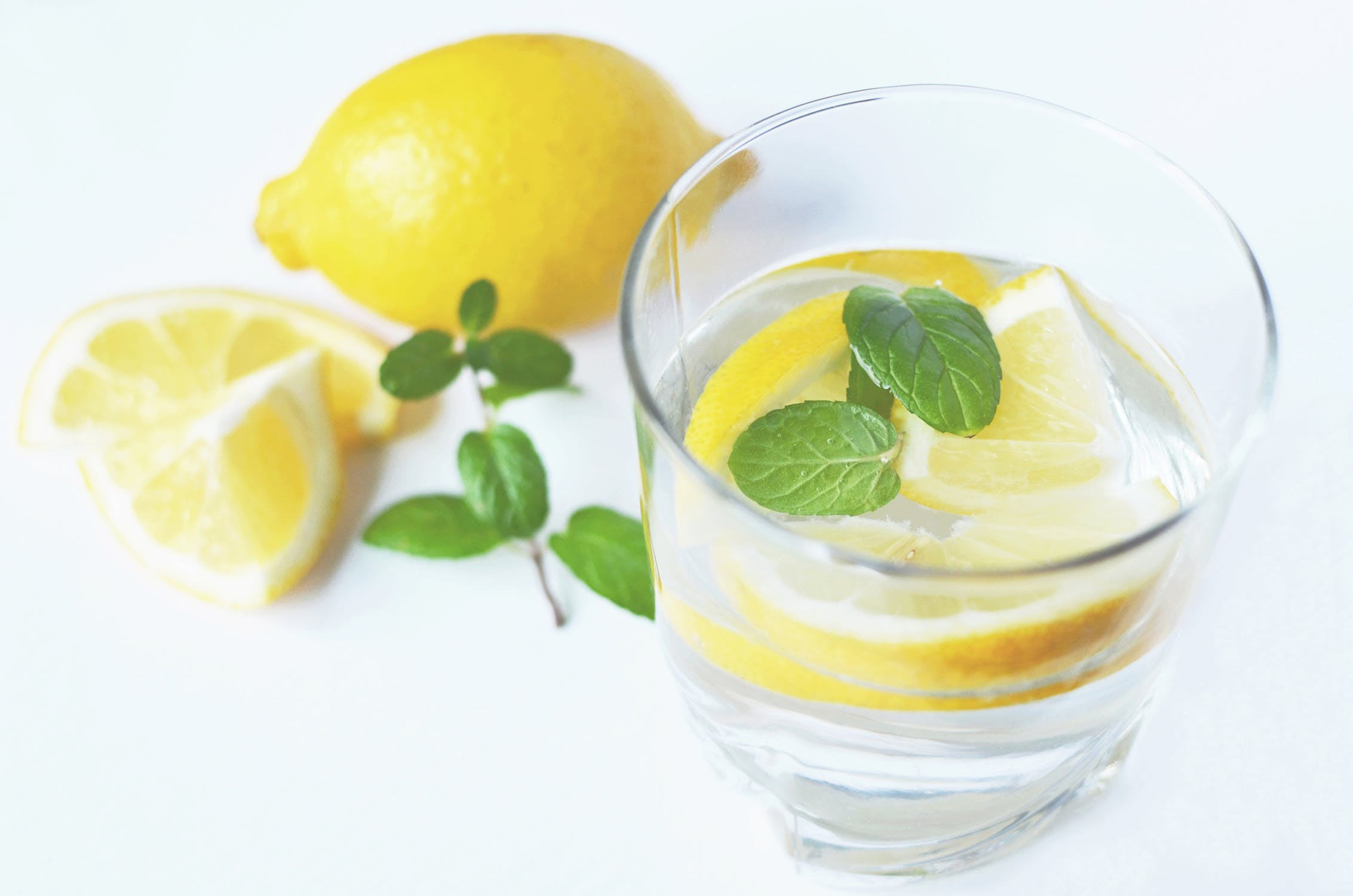drink lemon water - The easiest and most effective thing you can do is drink tons of water. I start with an ice cold glass of lemon water in the morning then end my day with the same. I also continue to drink tons of water throughout the day. I usually just add lemon, but feel free to add in mint, cucumber, or any other fruits you desire!Why it Works: The water provides hydration which allows your body to flush out any unwanted toxins. The lemons give you vitamin C which help boost your immune system and fight illness. They also aide in energy production AND detoxification!!