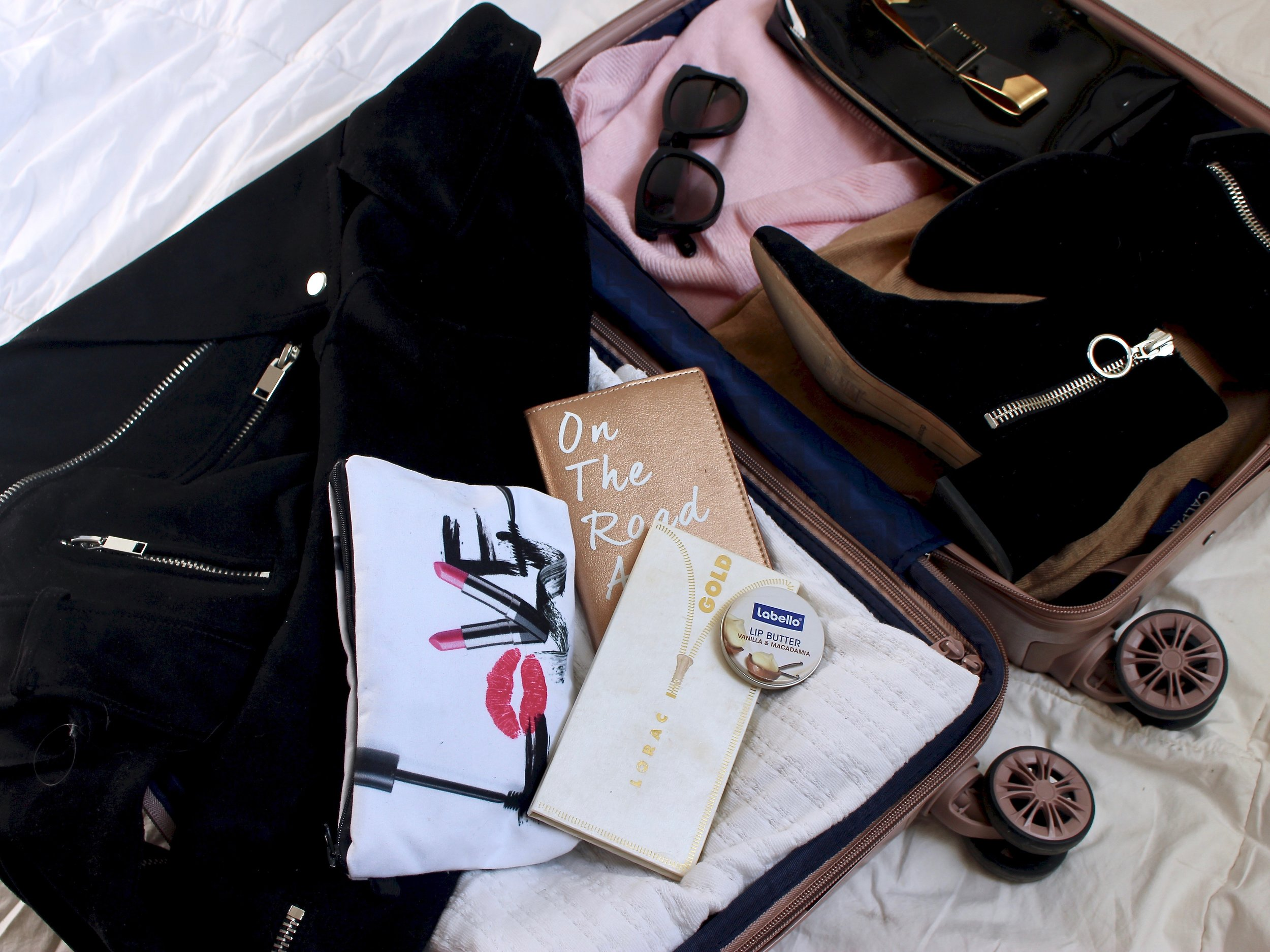Travel essentials to pack the perfect carry on by Au Courant Life