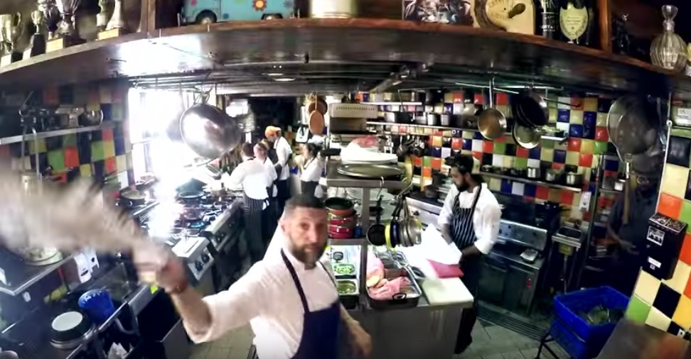 Inside the kitchen of Machneyuda restaurant. Film still from Machneyuda promotional video