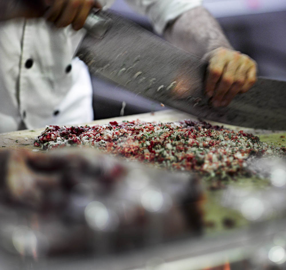 A chef chops meat for kebabs at the Diana restaurant, Nazareth.Photo by and ©Vision Studio