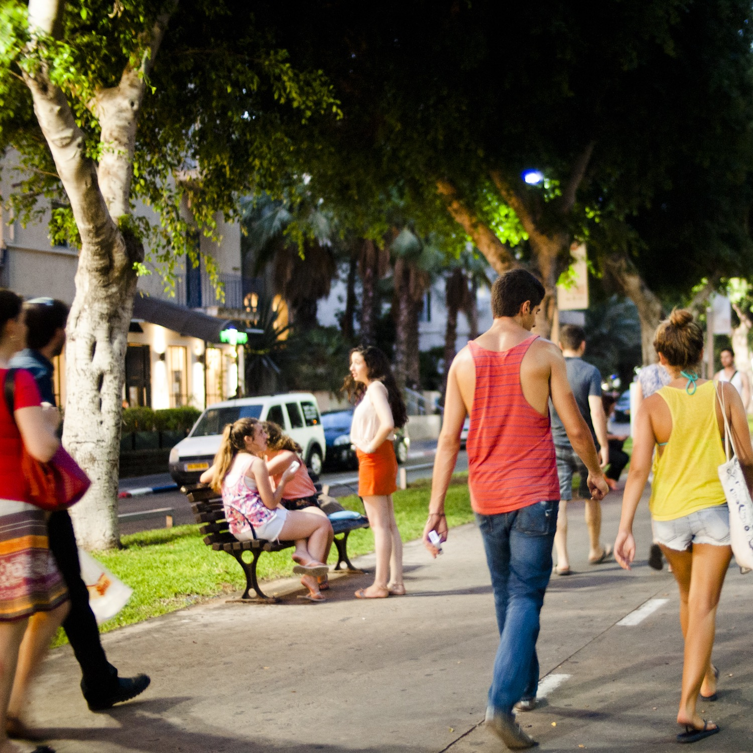Walking the tree-lined central boulevard of Sderot Rothschild.Photo by and ©Vision Studio