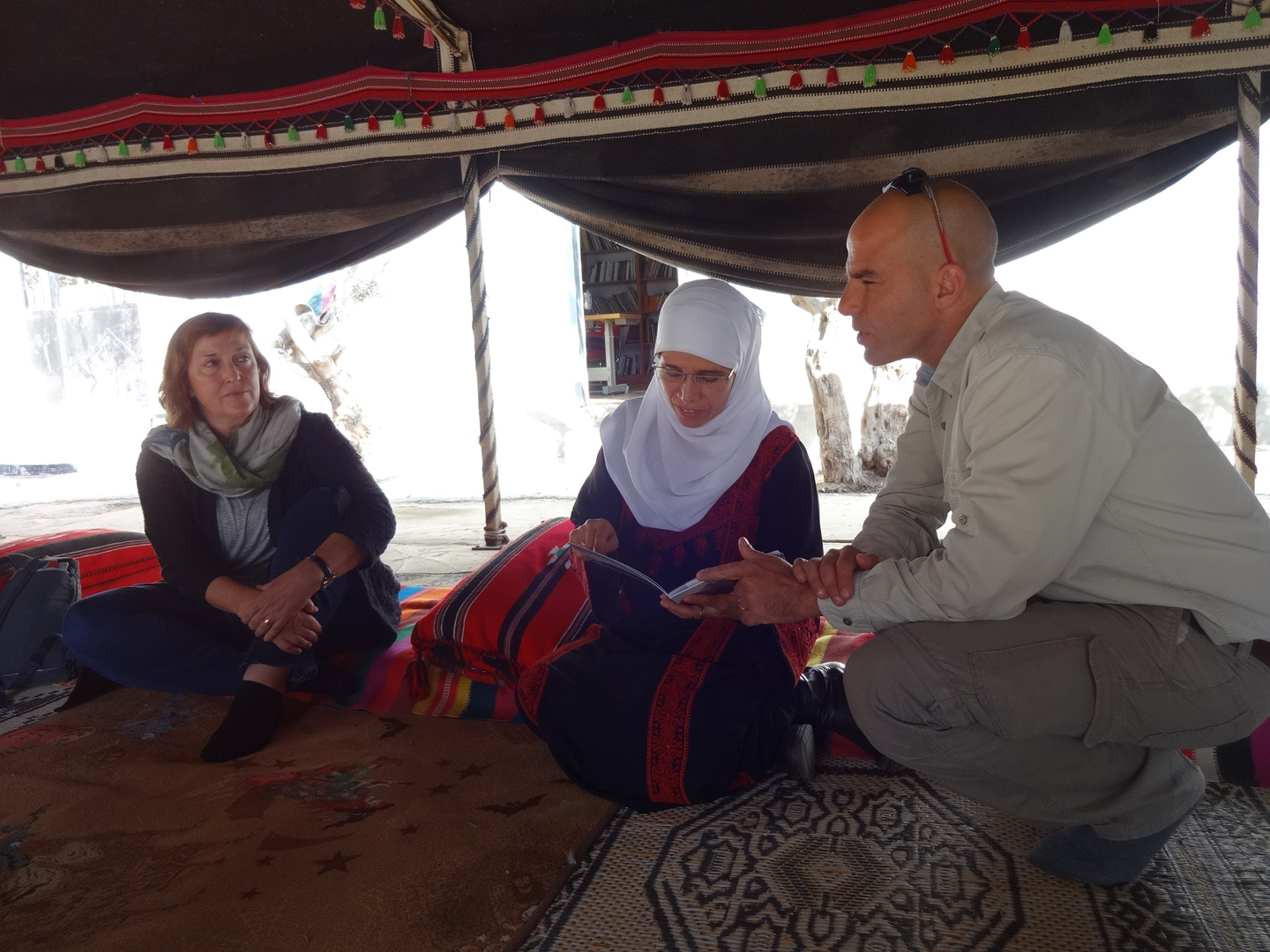 Diana with our guide, Jossef Idan, and Na'ama ElSana of the Women's Embroidery Project at Lakiya, featured in Art & Design.