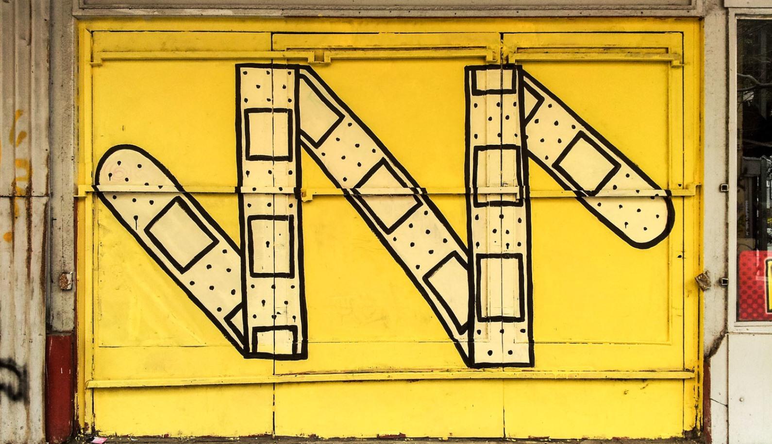 Band-aids, a telltale sign that Tel Aviv street artist Dede was here. Photo courtesy Israel21c