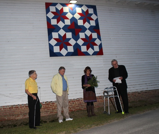 Chloe, her brother, and nephew, took a moment to gather under her newly mounted and lit quilt, alongside Rev. Jim Horton, for a private blessing ceremony.