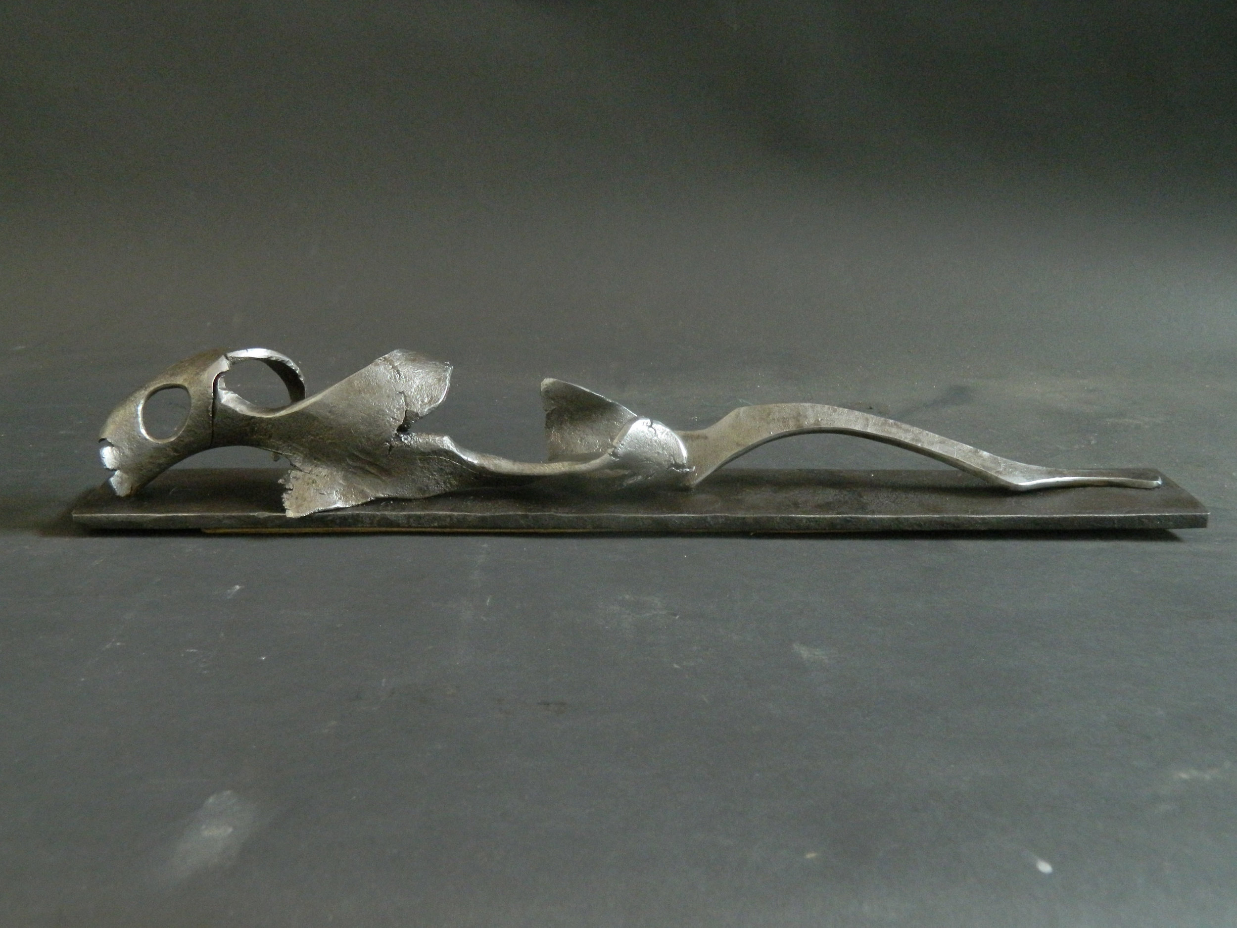 "Reclining - 17 X 3 "" in wrought Iron, by Lee Sauder"