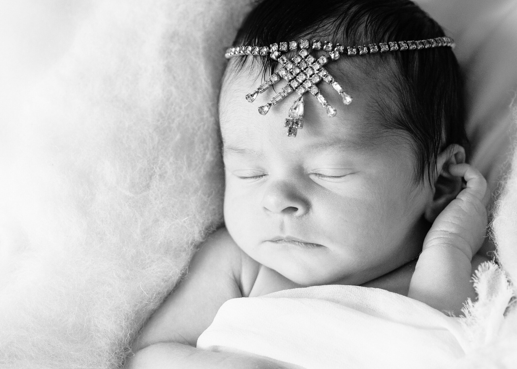 Newborn photo with jewelled headpiece