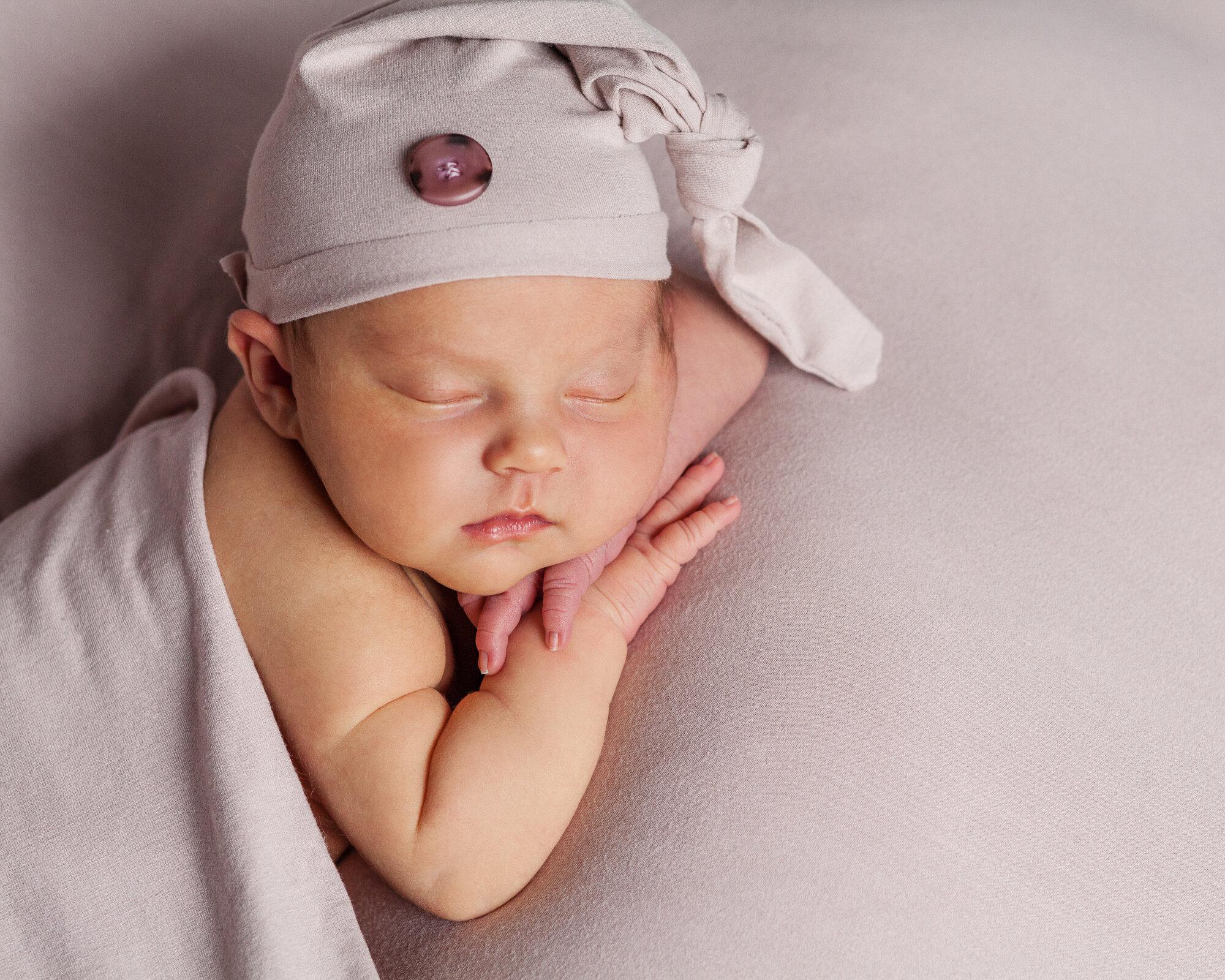 Newborn in sleep hat Newborn photography Vancouver