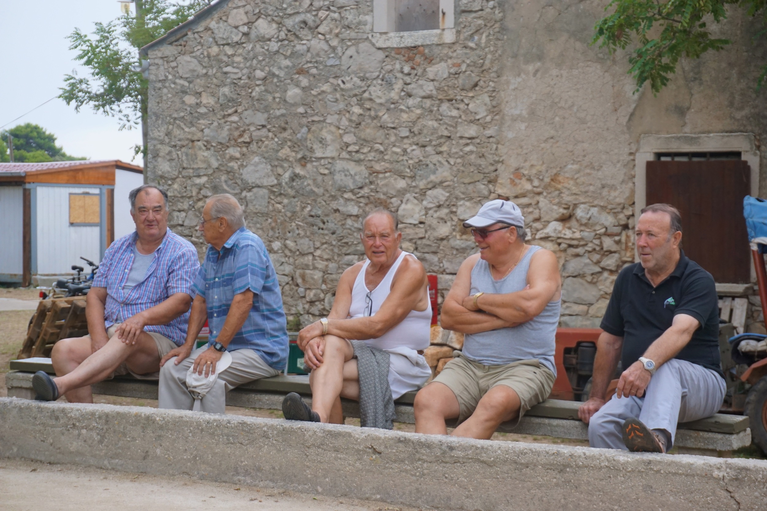 Some of the older guys on the island watching Bocci Ball.