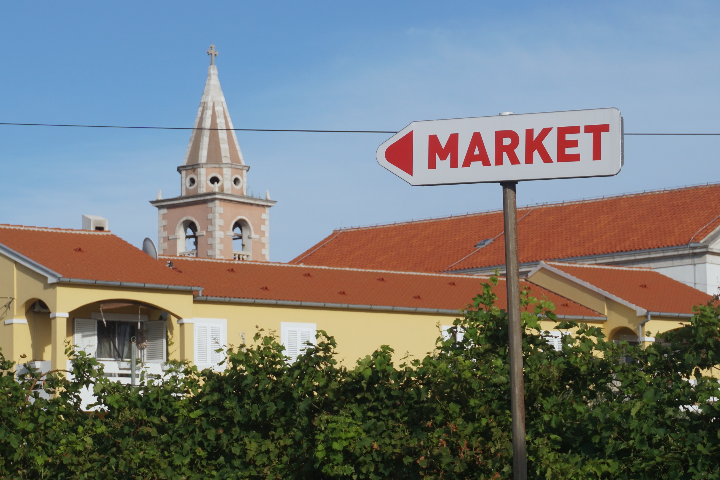 The sign to the Big Market, with the church in the background.