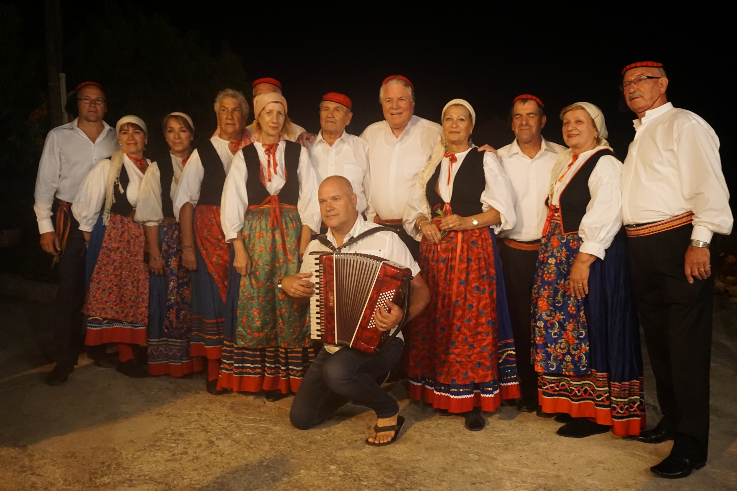 A photo of the group that danced for the Traditional Croatian dancing night on the island!