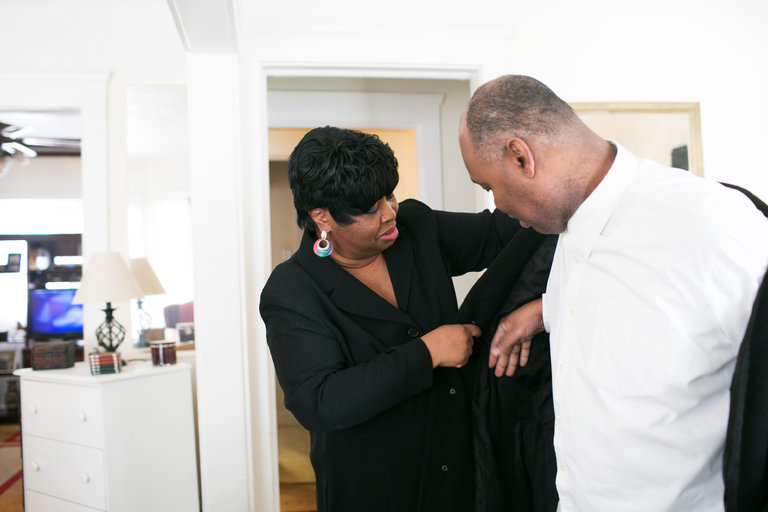 Thajuan Perry and her brother, Eric, at their home in Cleveland. Ms. Perry is a full-time caretaker of her brother, who had lead poisoning as a child and now must take antiseizure medication.