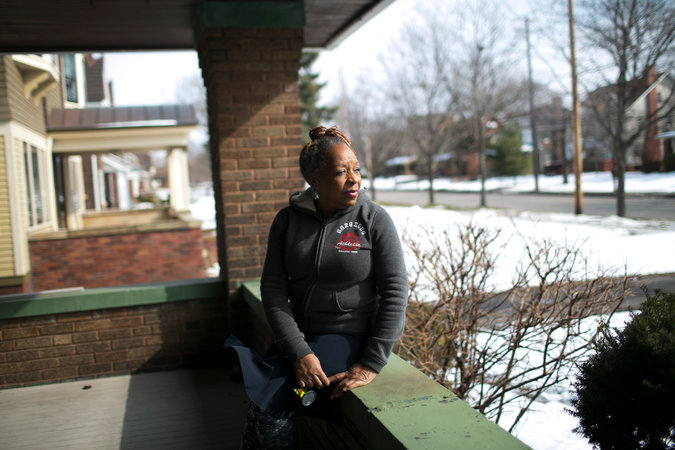 Charm Warren-Celestine at her home in the Glenville neighborhood of east Cleveland. She replaced the windows and porch of her century-old home after her toddler grandson developed high levels of lead in his blood after spending the summer with her in 2011.
