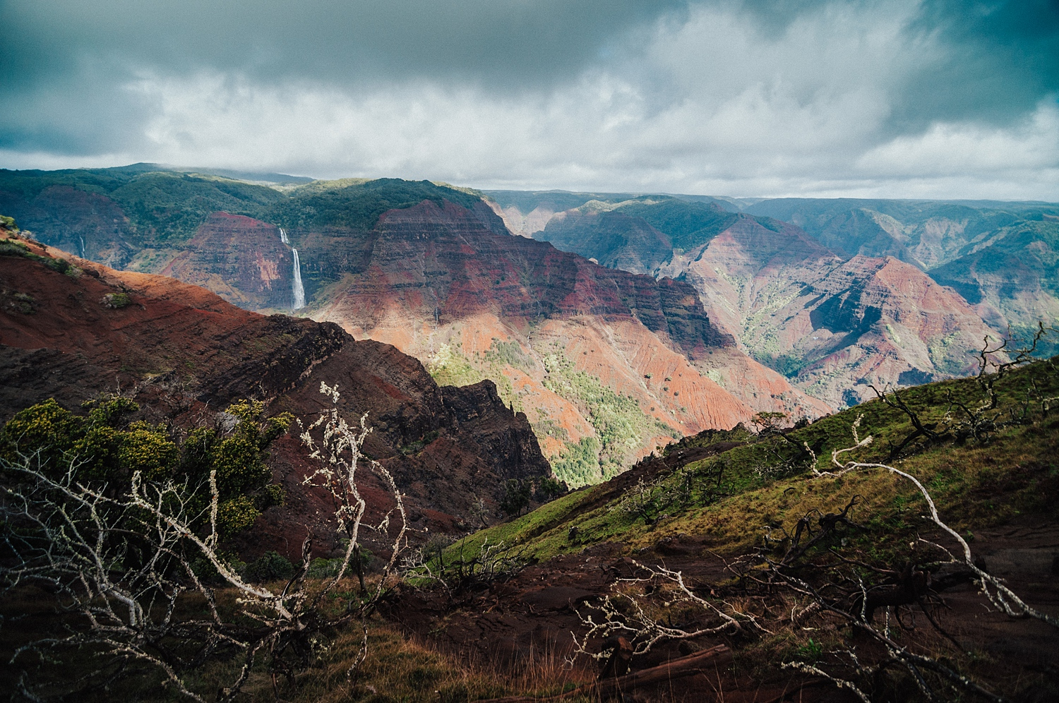 """KAUAI, HAWAII  Let's get one thing straight: Hawaii doesn't just have beautiful white sand beaches... Kauai is actually home to a massive """"Red Canyon"""" - one of my favorite spots on the Island."""