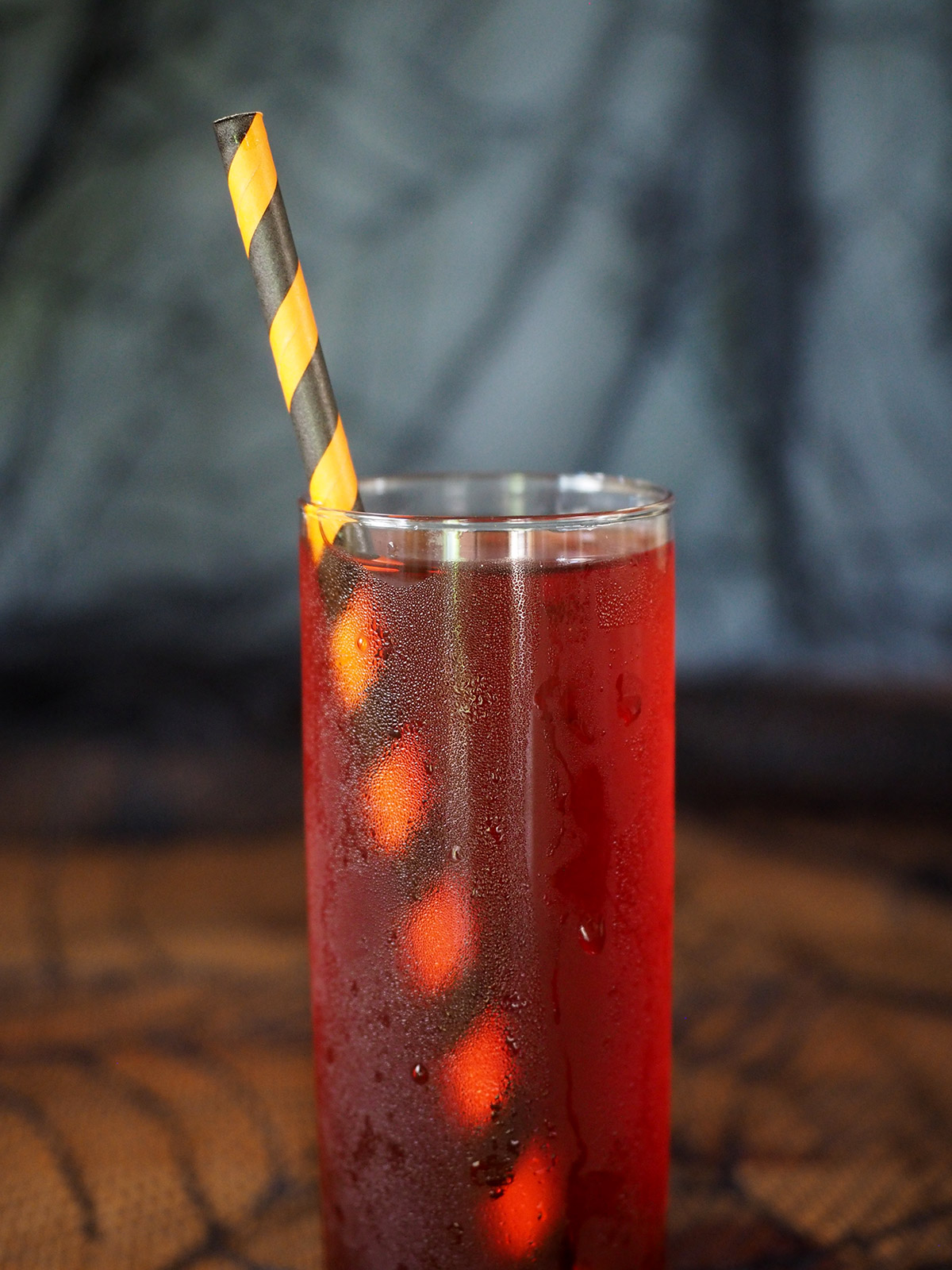 Perfect for Halloween, this cocktail has all the flavor of a Negroni but is lightened up with fruity Blood Orange Iced Tea and sweet maraschino cherries. It's a spooky and bloody drink for a Halloween party or night of candy duty.