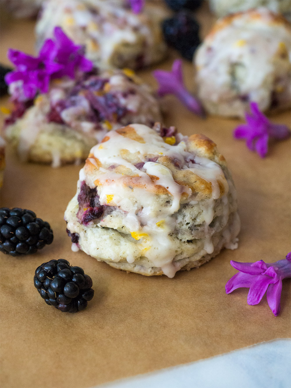 Earl Grey Blackberry Scones with Lemon Glaze. Fresh blackberries, zesty lemon and rich Earl Grey tea make up this super delicious scone. Perfect for guests or just a lazy Sunday afternoon. Easy to freeze and reheat.
