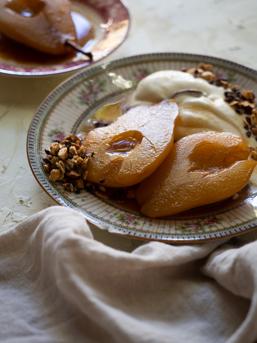 Juicy pears are poached in a sweetened Earl Grey tea for a simple but delicious dessert. Serve with freshly whipped cream and hazelnut cacao granola for a grown up dessert.