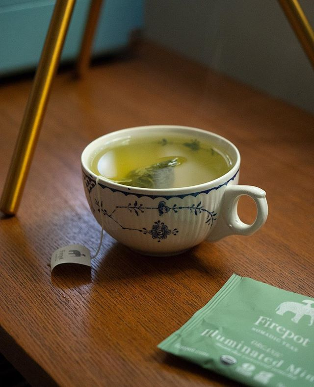 Deep breath in, deep breath out 🙏 I'm starting this #MatchaMonday with @FirepotNomadicTeas Illuminated Mind (Matcha Covered Sencha). I really love their Rituals Collection Teas. Each tea is paired with a ritual & wisdom for wellness. Here is the ritual for Illuminated Mind:⠀ ⠀ RITUALS FOR FINDING CLARITY & FOCUS⠀ ⠀ Stand tall like a mountain, then alternate balancing on each side. Write down 3 characteristics in yourself and others that inspire you.⠀ ⠀ Indulge in a forest bath, shinrin-yoku, by simply walking in the woods, opening your senses to the energy there. Bring along a thermos of Illuminated Mind green tea.⠀ ⠀ Rub a few drops of clary sage or rosemary essential oils on your temples.⠀ ⠀ Affirmation: By staying in the present, I create mental clarity in my life.⠀ ⠀ Sip Illuminated Mind after your morning meditation.