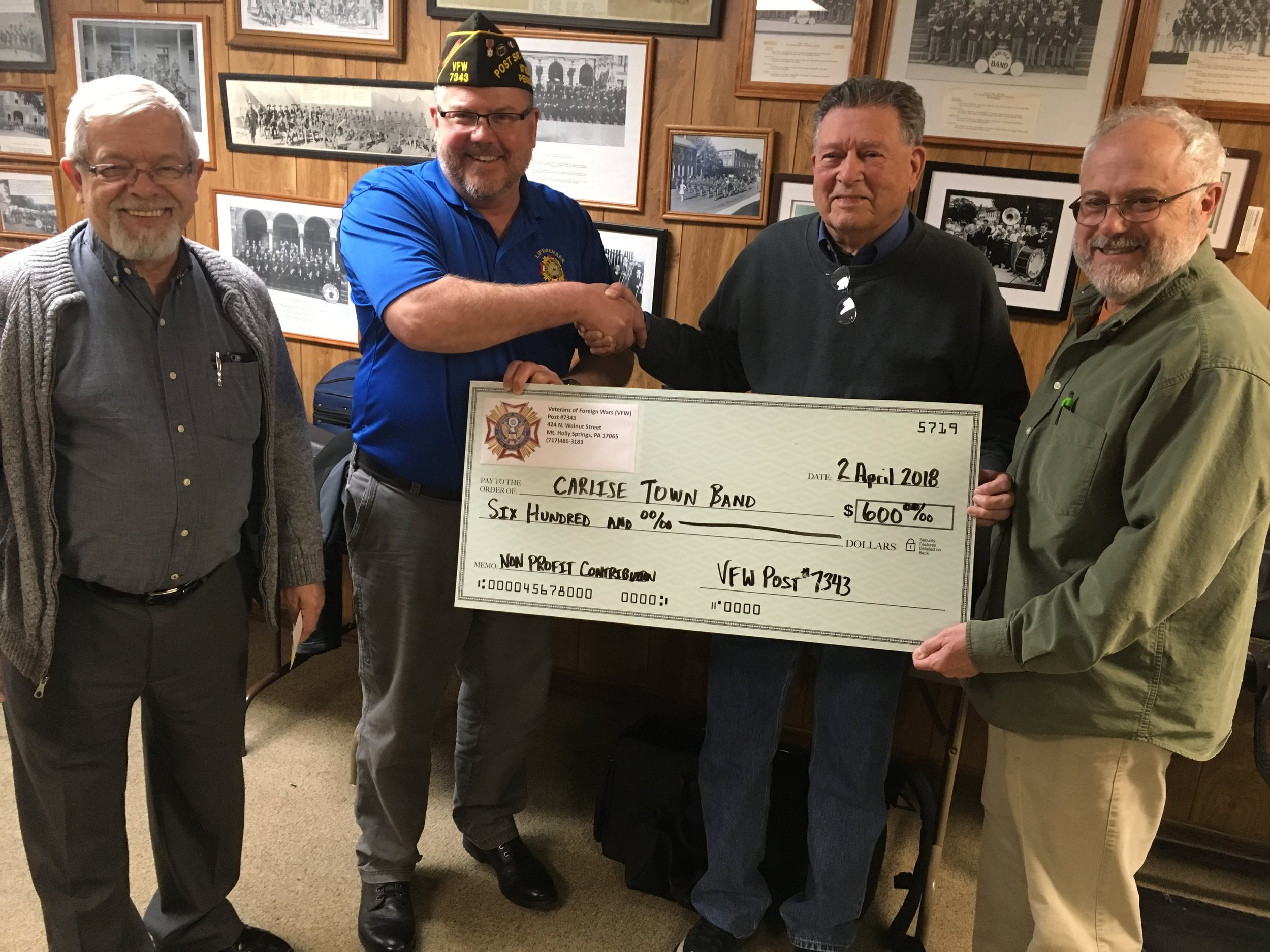 Reinhard Beel, Bob Loy & Jim Shufelt accept donation from VFW Post