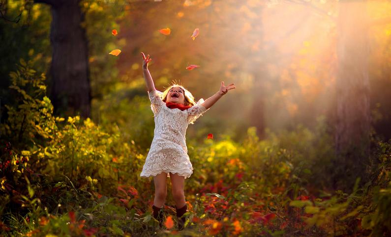happy_girl_in_woods.jpeg