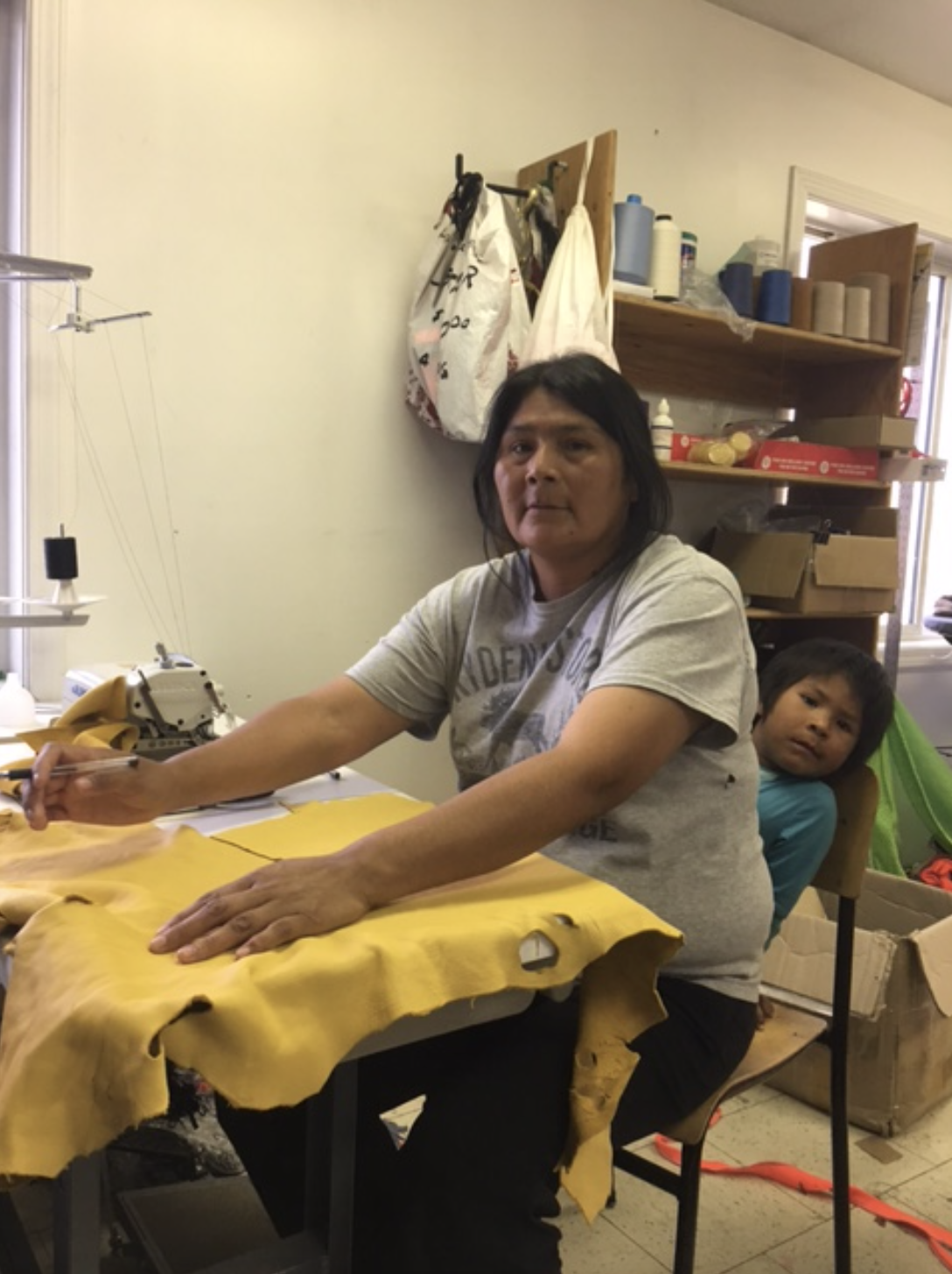 This is Sheila, who is a very talented and creative woman. Everly is the youngest of 6 children and comes with her to KASKii. Sheila is training to be a sewing machine operator.