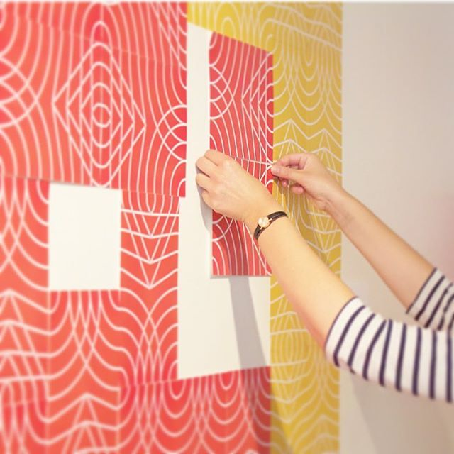 Visitors trying out the variations of the Rotation pattern at the exhibition. Print out your own on patternprinterproject.com #patternprinterproject #wallpaper #wallpapers #design #interiordesign #rotation #exhibition #interaction #papertiles #diy #diyinterior #wallpower