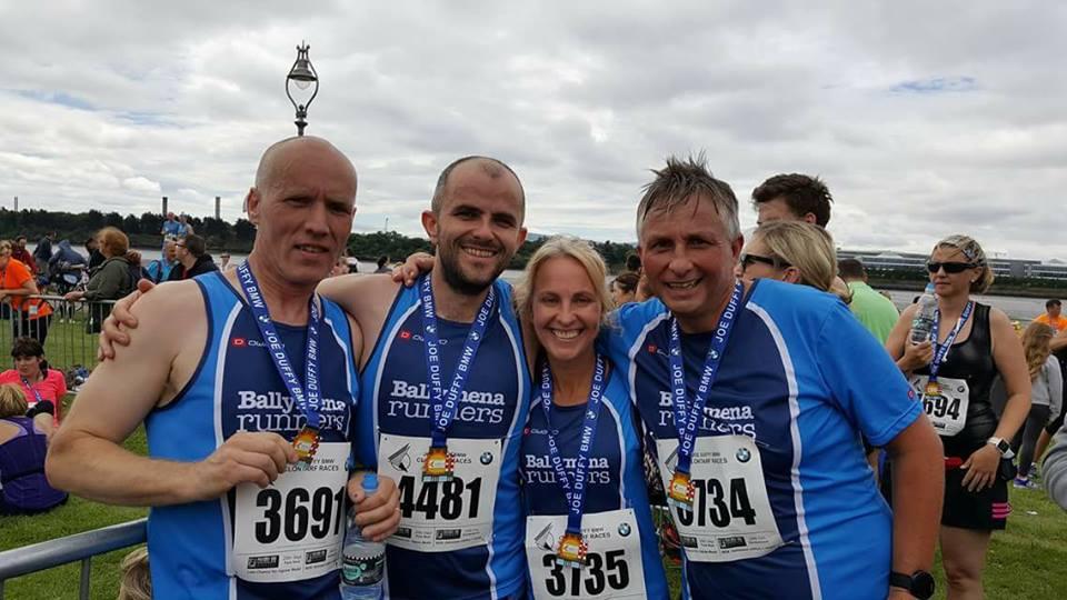 Glenn McGall, Chris Young, Moyra McKinley and Paul McKinley complete the Clontarf Half Marathon