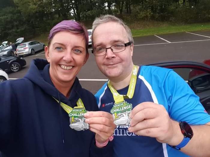 ... and Judith Irwin and Martin Harris with their medals