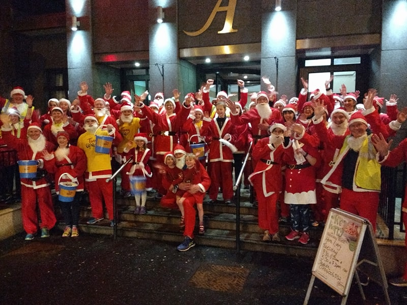 On the steps of the Adair Arms Hotel during the club Santa Run