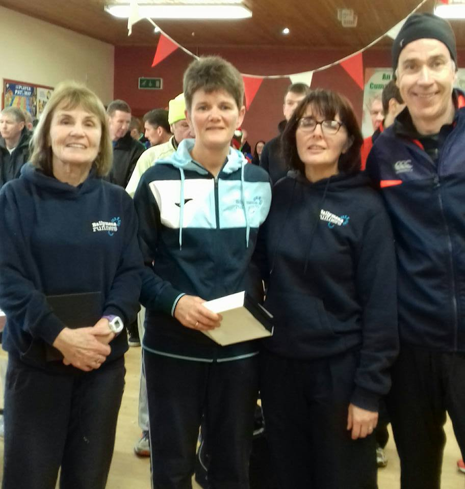 Brigid Quinn, Linda Petticrew, Aine Hasson and John Hasson after the Greencastle 5-Mile Race on Boxing Day