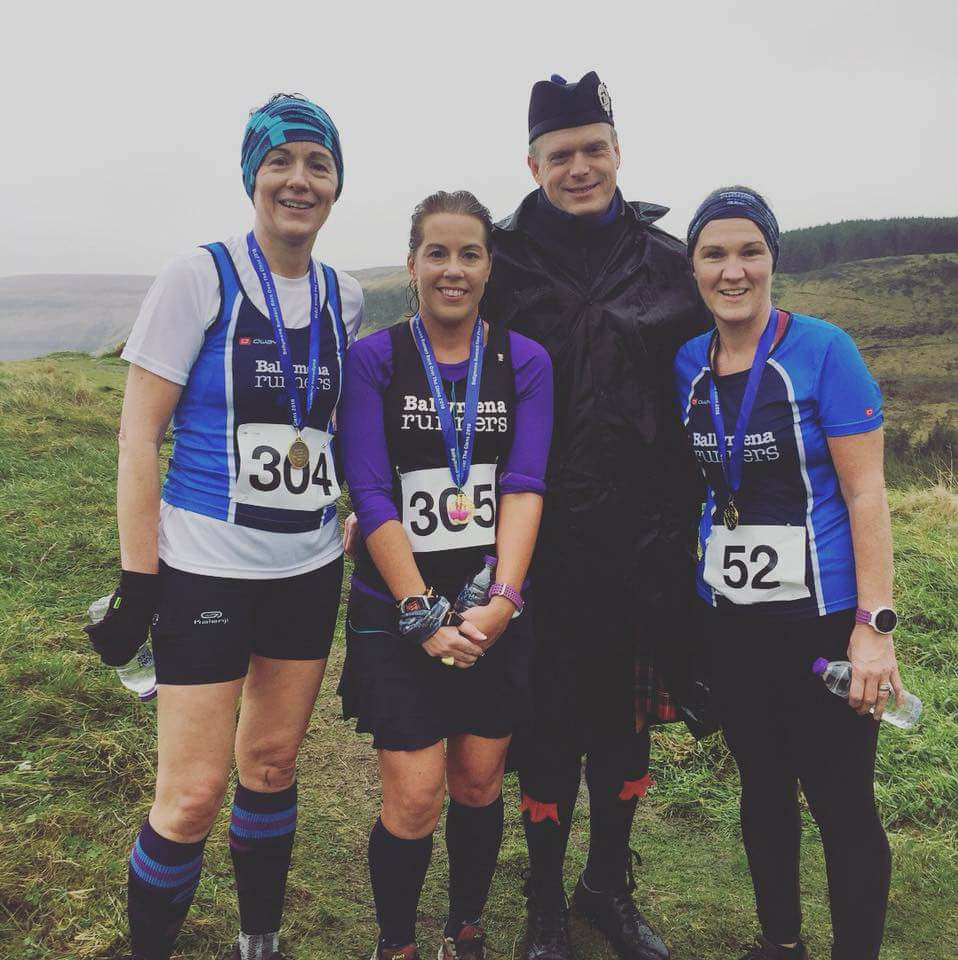 Andrea Wylie, Helen McCormick and Geraldine McClintock with piper Ewan MacDonald after Race Over The Glens
