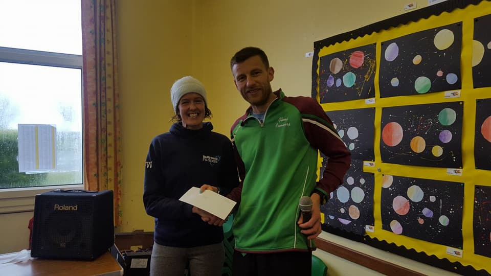Gillian Wasson receives her age category prize at the Spud Run