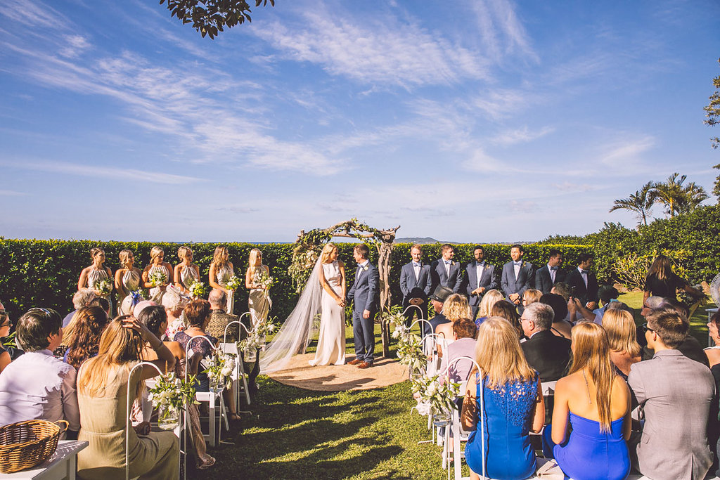 """C + A's Byron Bliss Wedding - """"We could not have been happier with our beautiful florals! Lisette took the time to work with us, understand what we wanted, what our budget was and then transformed that into the most gorgeous floral displays. People still comment on the amazing arbor flowers!""""~Claire (Bride)"""