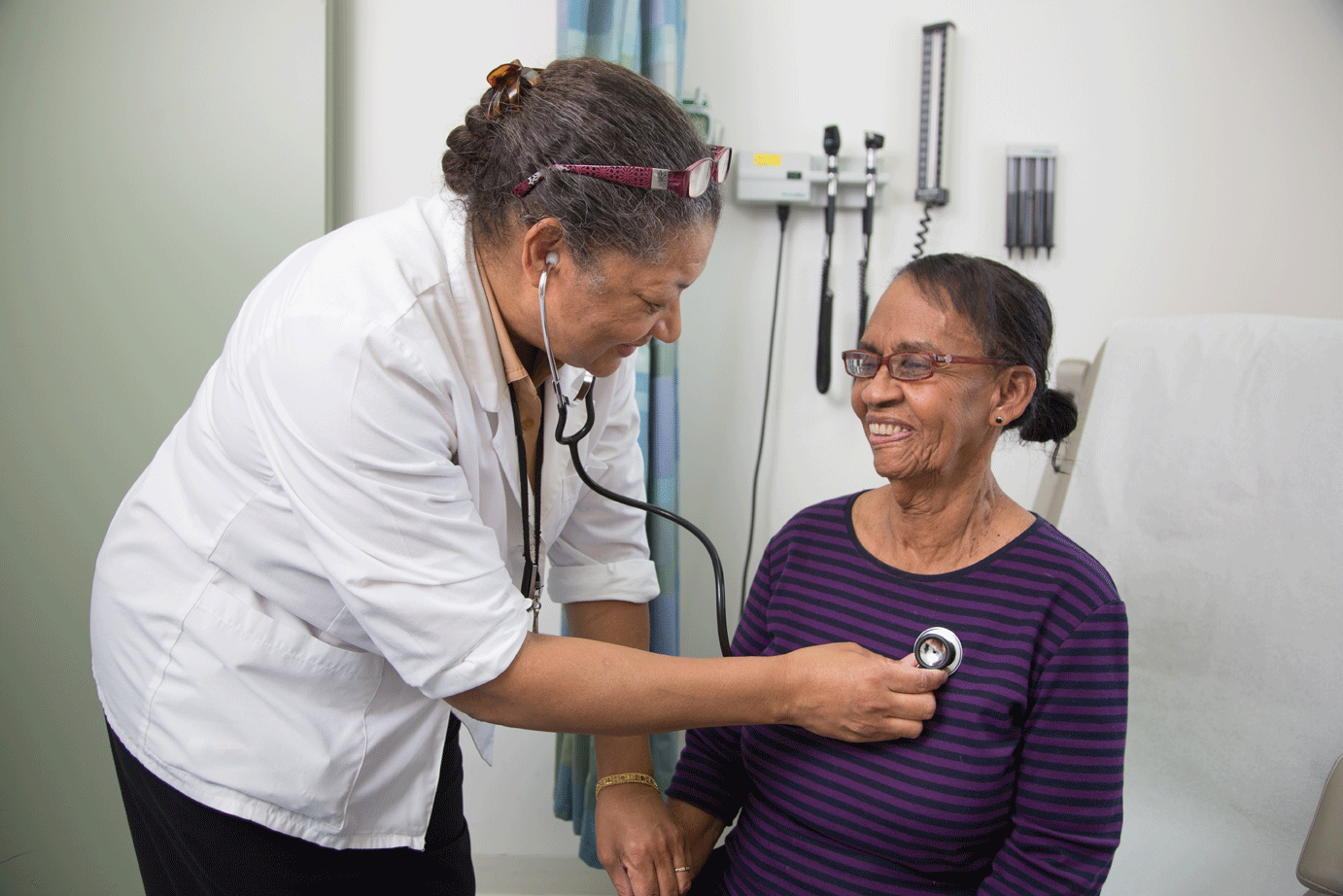 woman and nurse with stethoscope