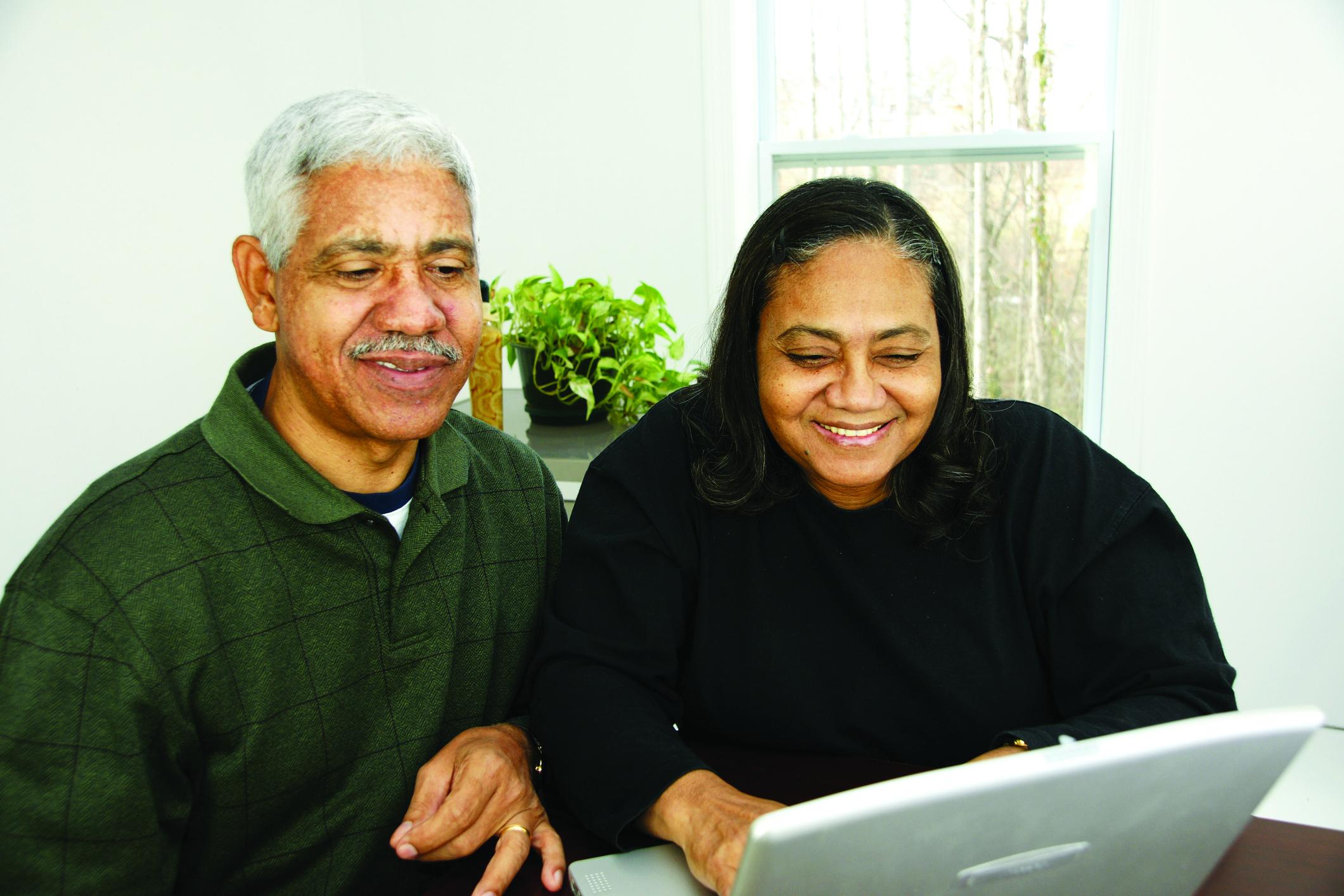 elderly couple on the computer
